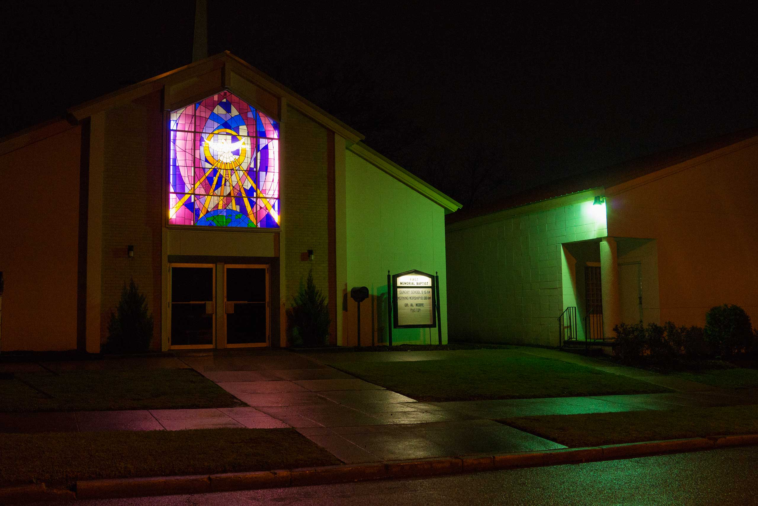 The stained glass glows at night from inside the First Memorial Baptist Church in Birmingham, Ala. on March 21, 2015.
