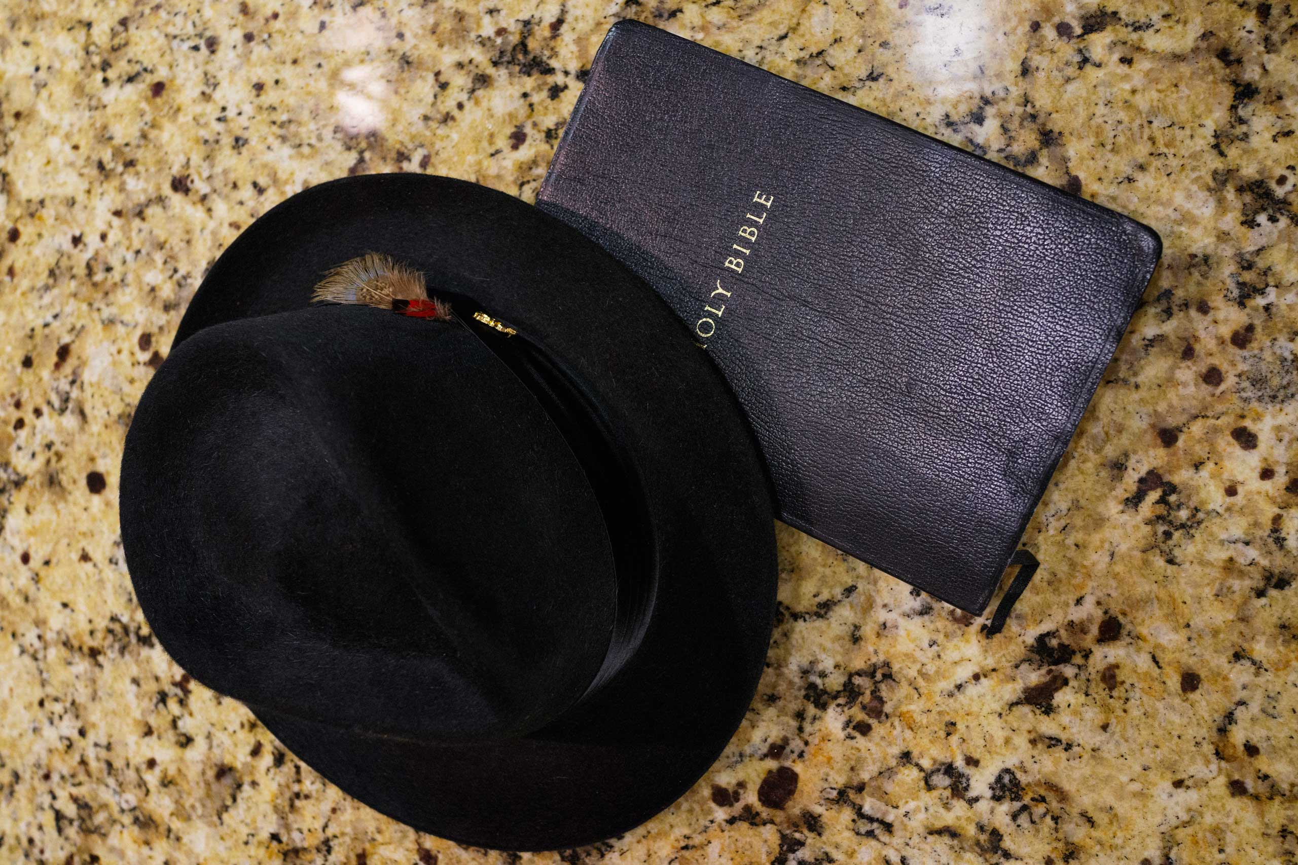 Pete Garrett's hat and bible rest on the kitchen counter of his home in Trussvile, Ala.