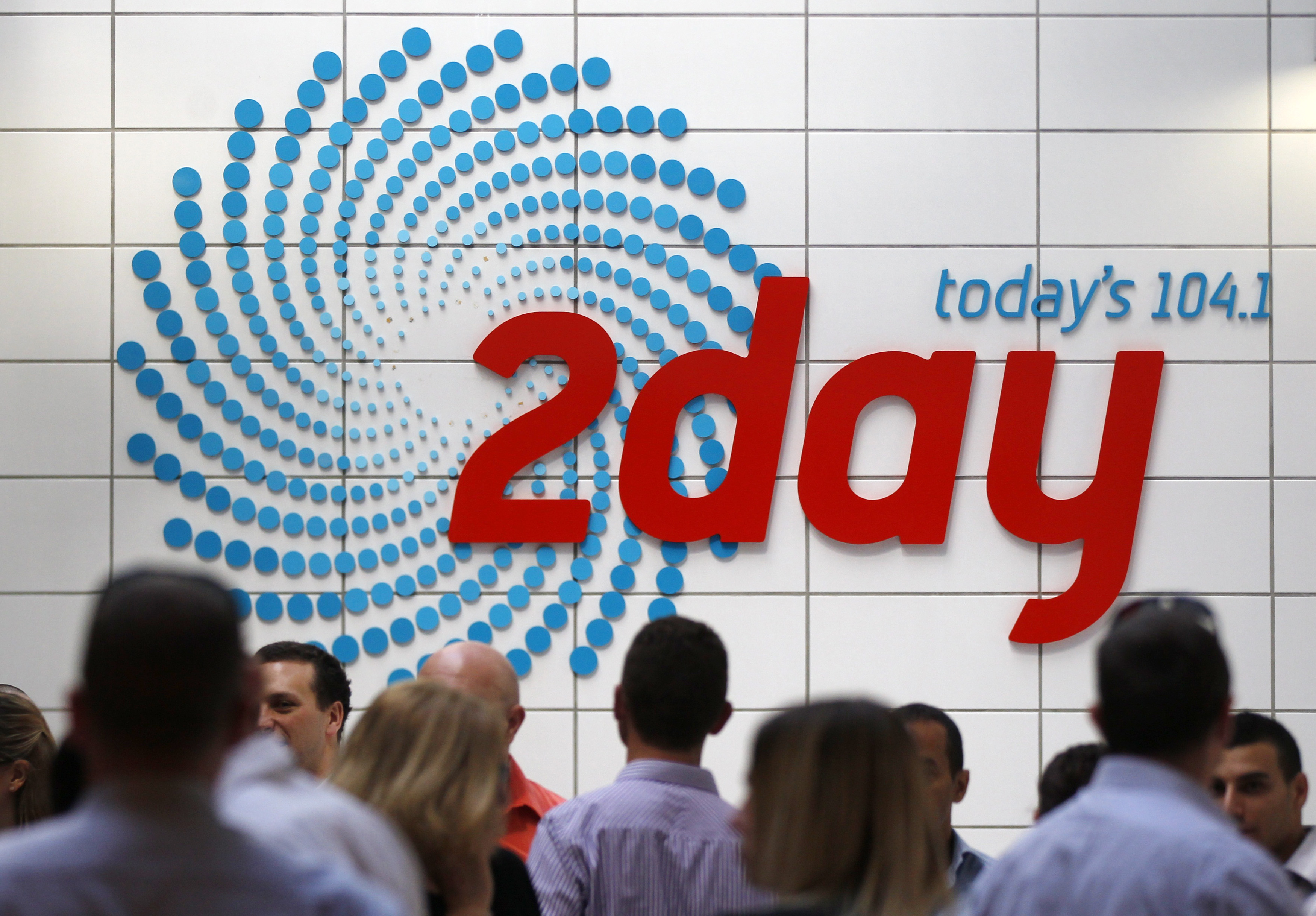 People gather in the foyer of the building that houses the 2Day FM radio station in Sydney December 6, 2012.
