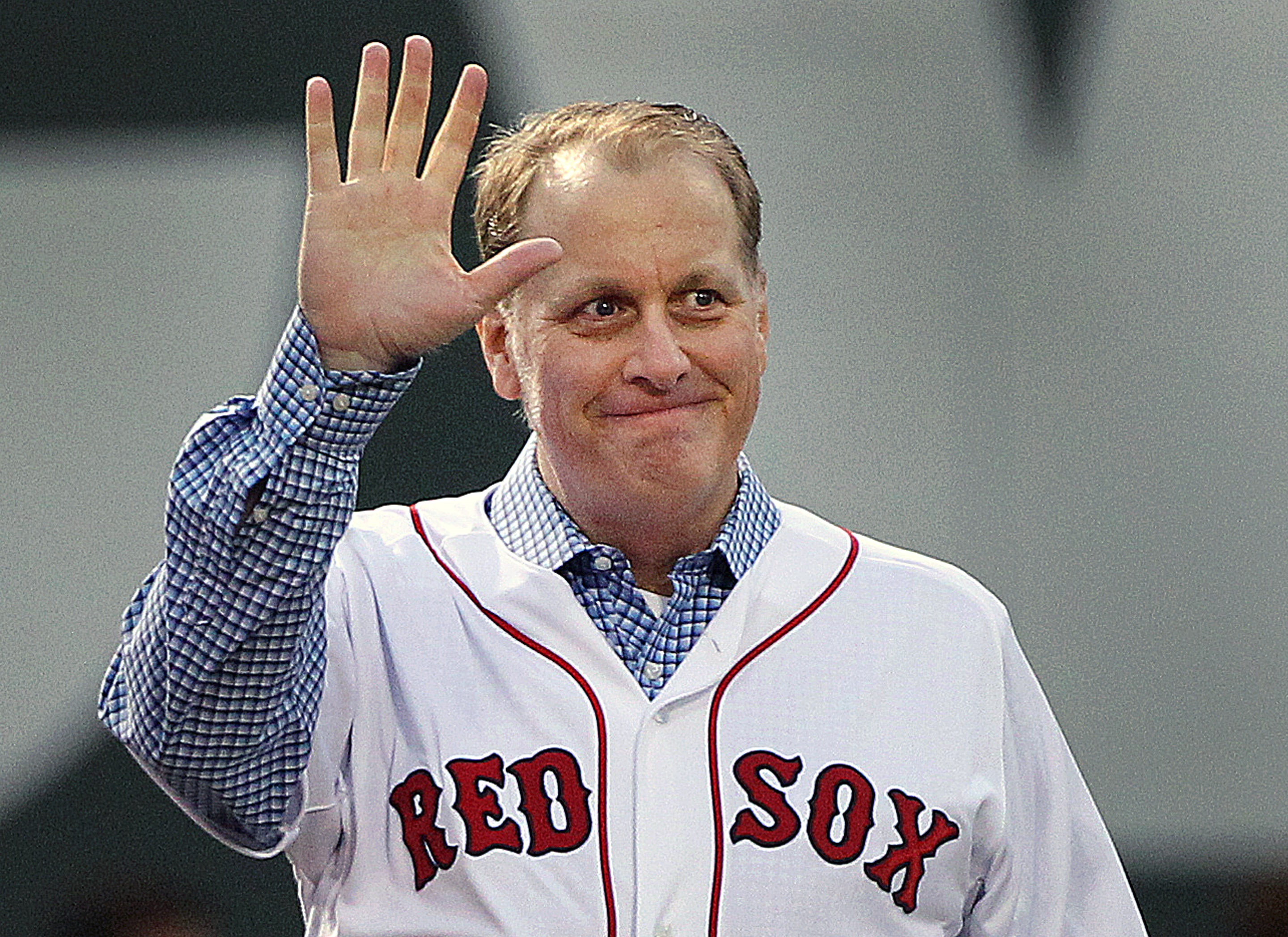 Former Boston Red Sox pitcher Curt Schilling is honored before a game between the Red Sox and the Atlanta Braves on May 28, 2014 in Boston.