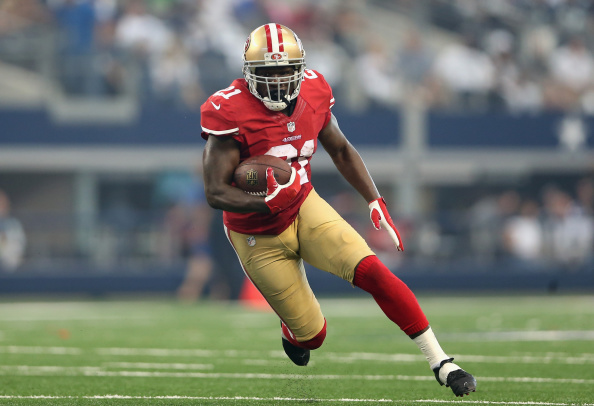 Running back Frank Gore of the San Francisco 49ers rushes the football against the Dallas Cowboys at AT&T Stadium in Arlington, Texas, on Sept. 7, 2014