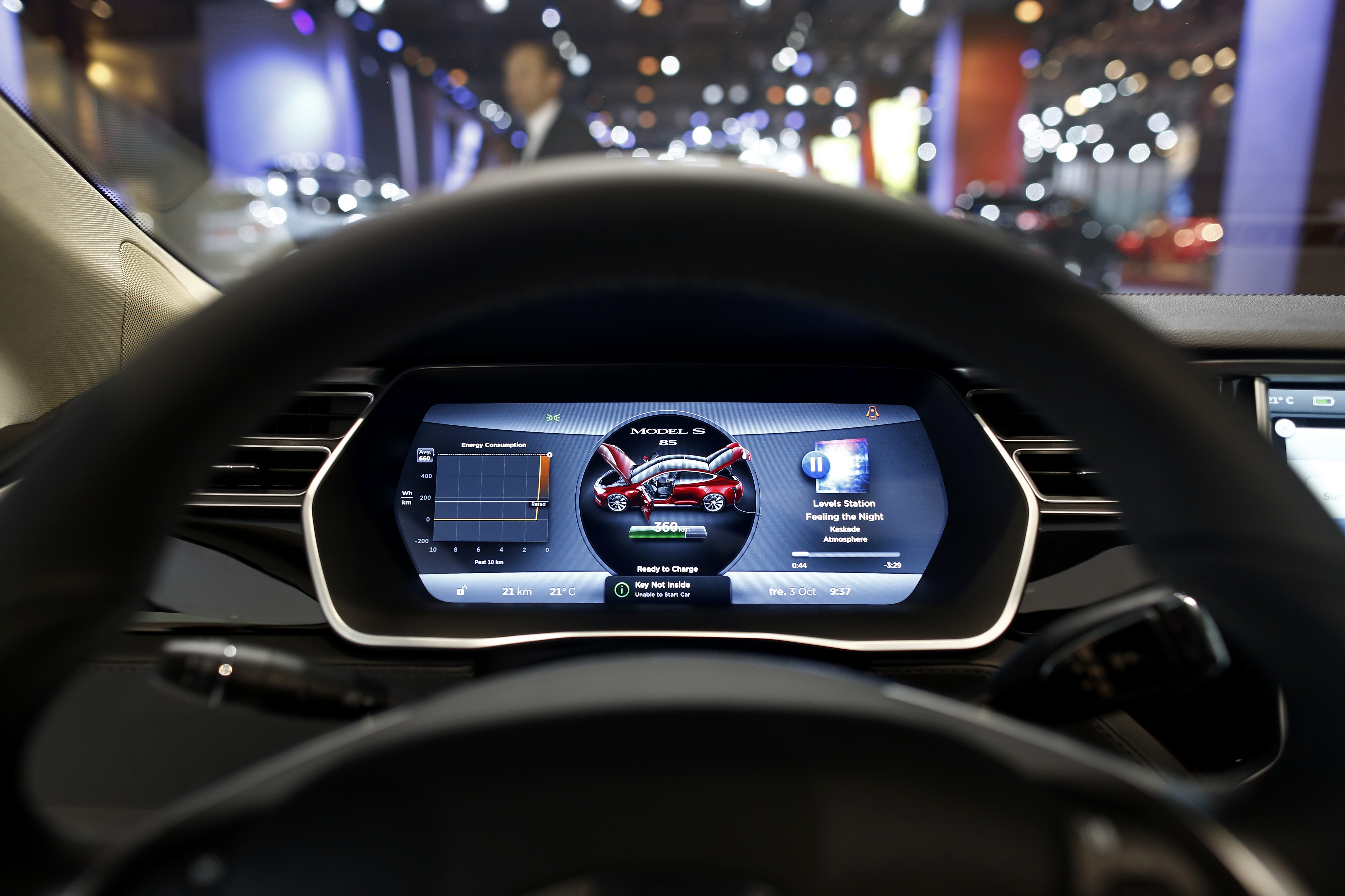 The driver's electronic dashboard sits illuminated inside a Tesla Model S automobile, produced by Tesla Motors Inc., at the Paris Motor Show on the final preview day in Paris, France, on Friday, Oct. 3, 2014.