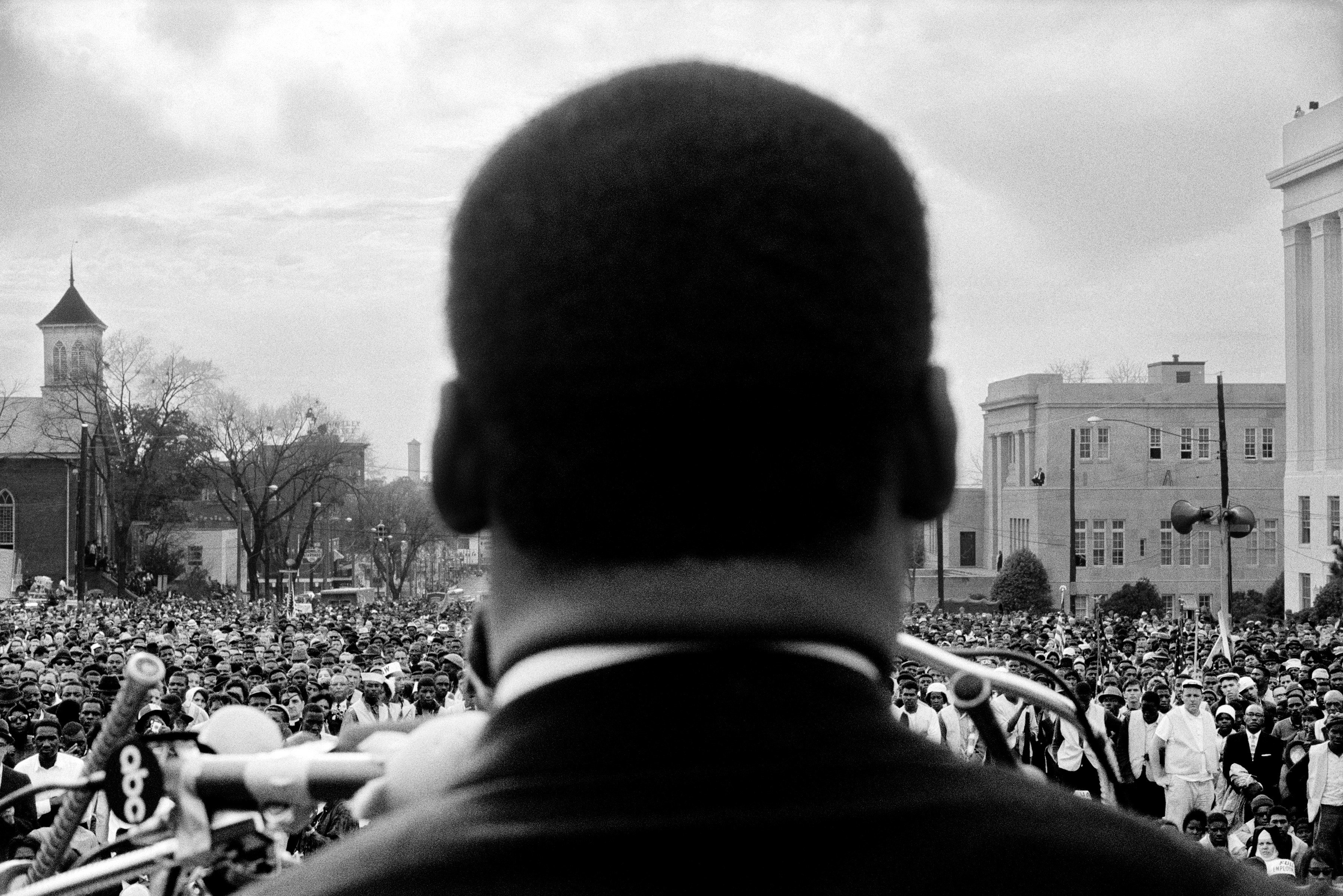 Dr. Martin Luther King, Jr. spoke in front of 25,000 civil rights marchers at the conclusion of the Selma to Montgomery march in front of Alabama state capital building on March 25, 1965 in Montgomery, Ala.