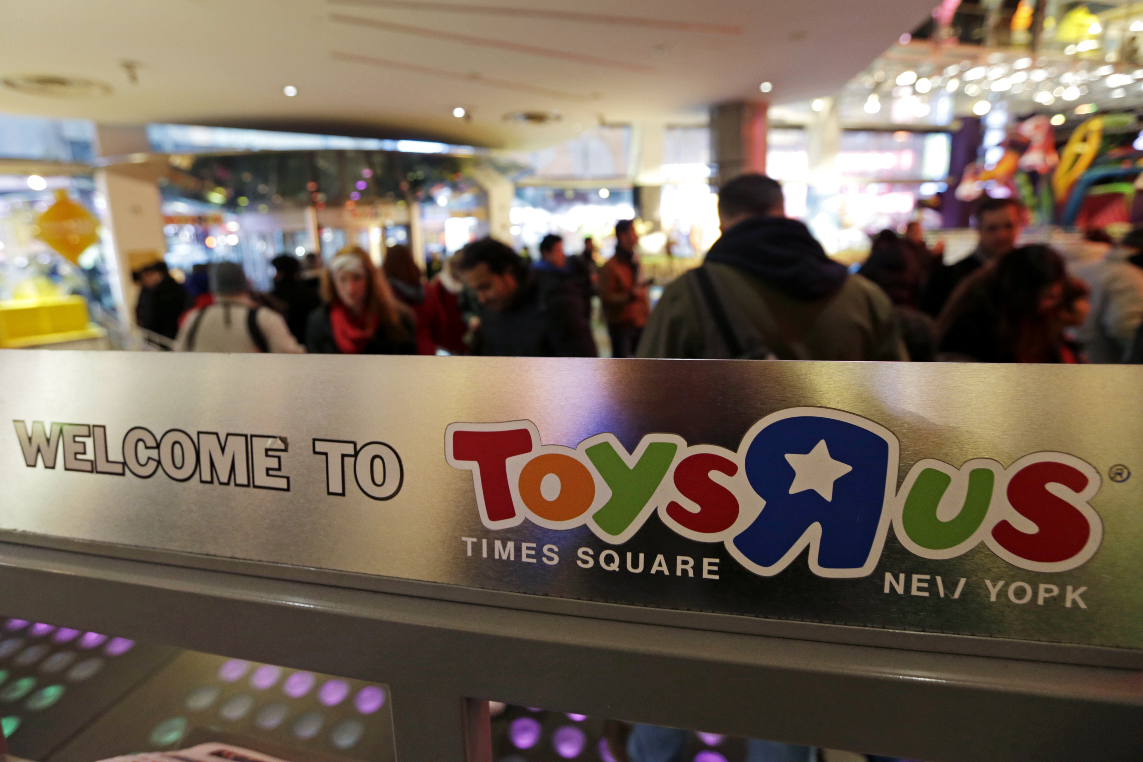 The Toys R Us Inc. logo is displayed inside a store ahead of Black Friday in New York, U.S., on Thursday, Nov. 27, 2014