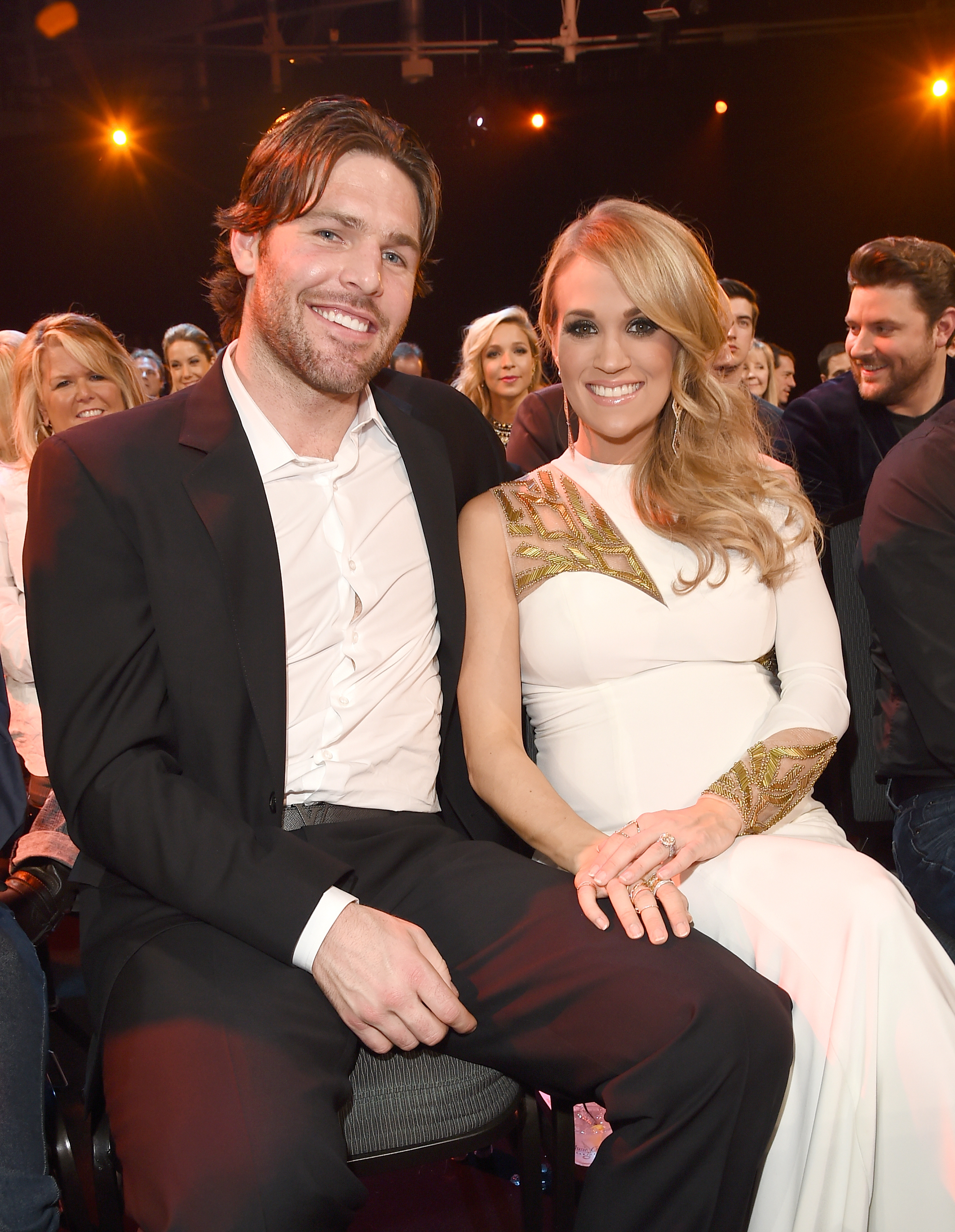 Professional hockey player Mike Fischer (L) and recording artist Carrie Underwood attend the 2014 American Country Countdown Awards in Nashville, Tenn. on Dec. 15, 2014.