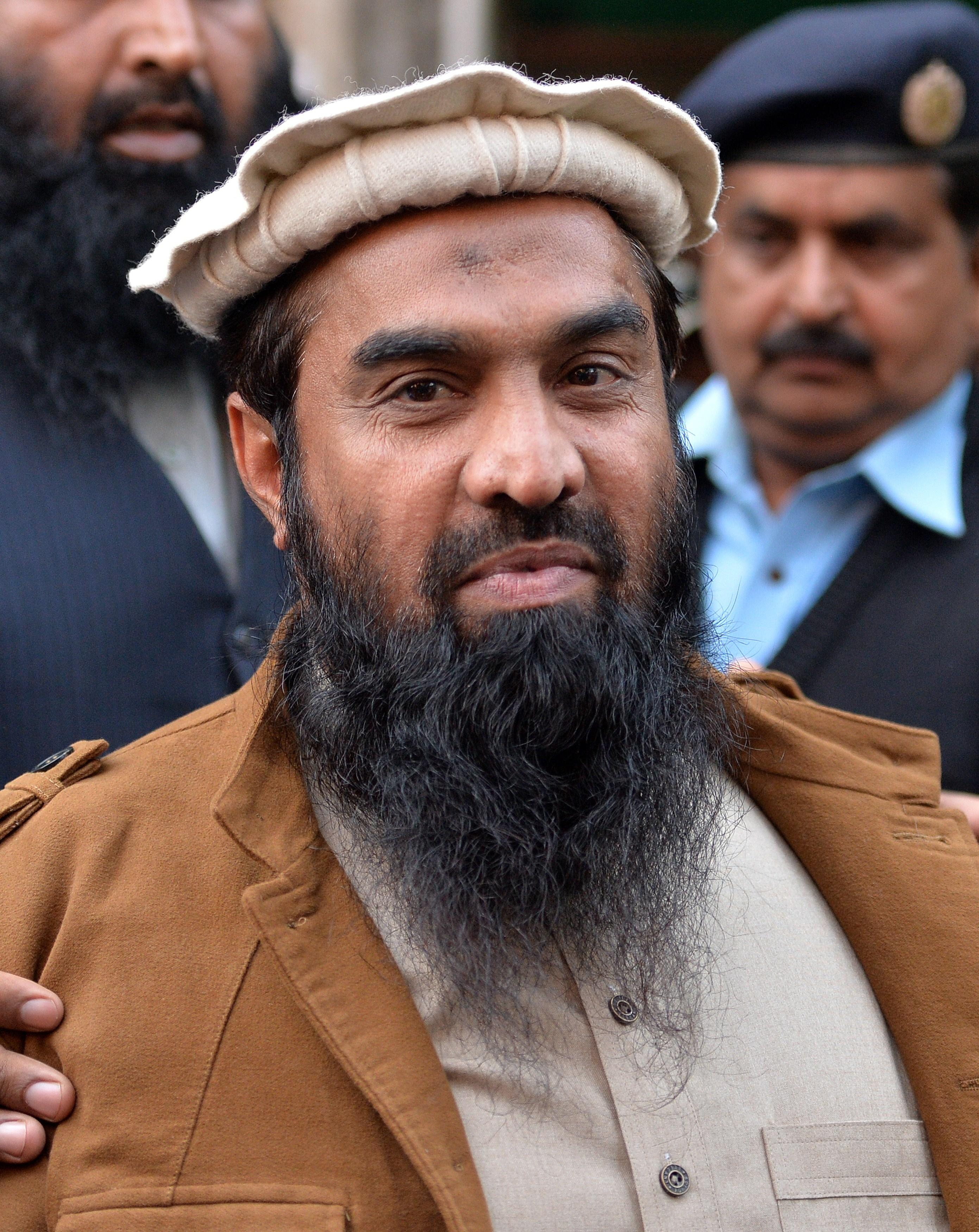 Pakistani security personnel escort Zaki-ur-Rehman Lakhvi, alleged mastermind of the 2008 Mumbai attacks, as he leaves the court after a hearing in Islamabad on Jan. 1, 2015