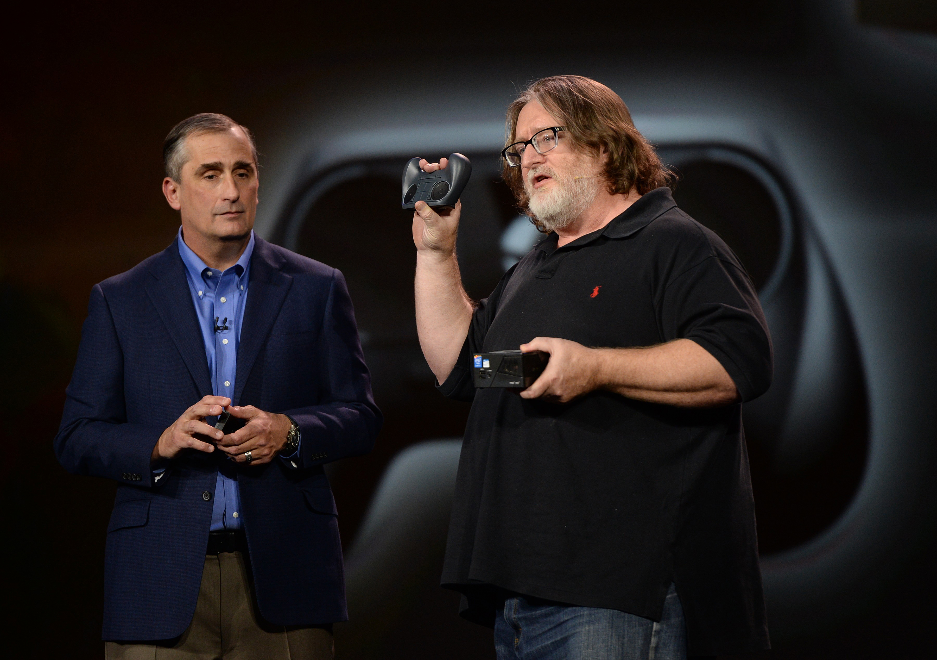 Intel Corp. CEO Brian Krzanich (L)  and Gabe Newell, co-founder of game-maker Valve, discuss Intel's role in Valve's gaming development, during Krzanich's keynote address at the 2014 International CES.