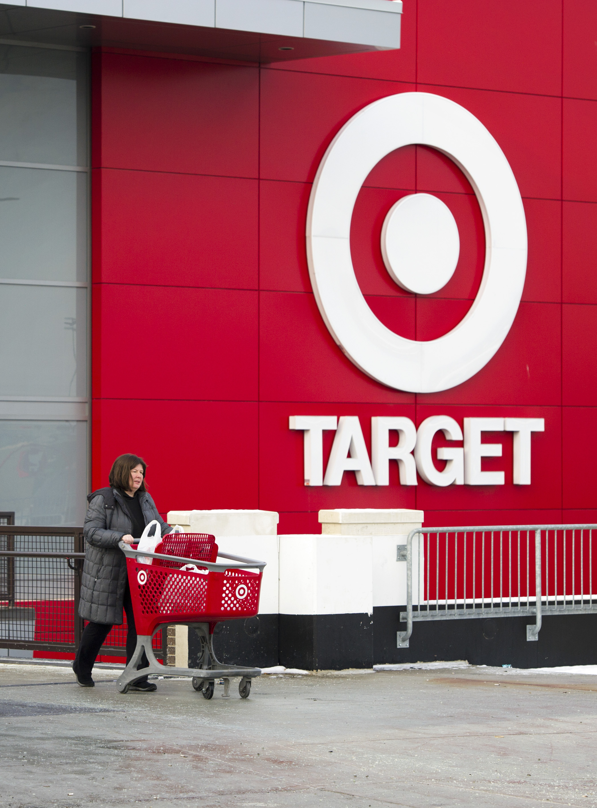 Shopper Laura Steele leaves a Target store in Toronto, Ontario, Thursday, January 15, 2015.