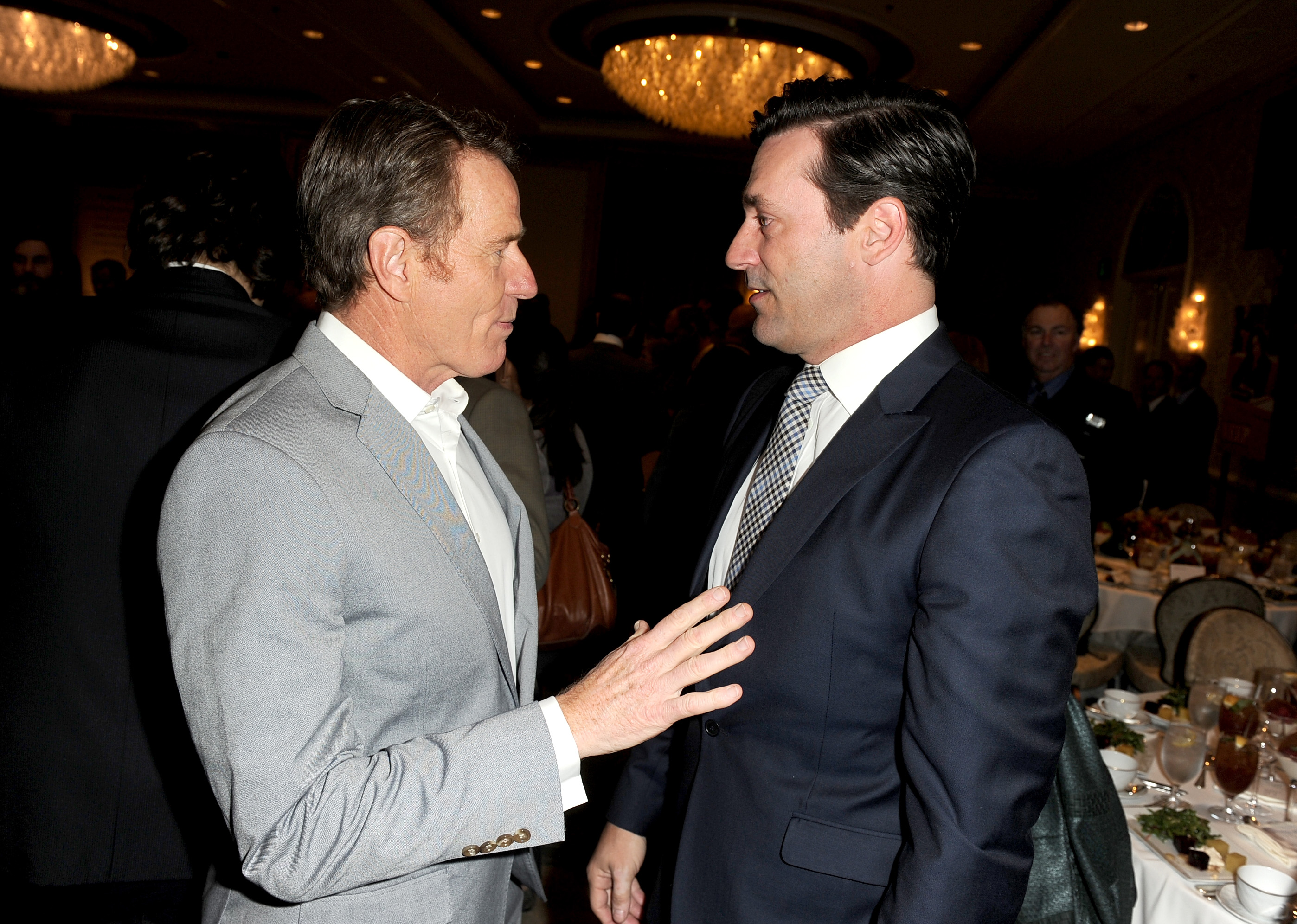 Actors Bryan Cranston (L) and Jon Hamm attend the 14th annual AFI Awards Luncheon