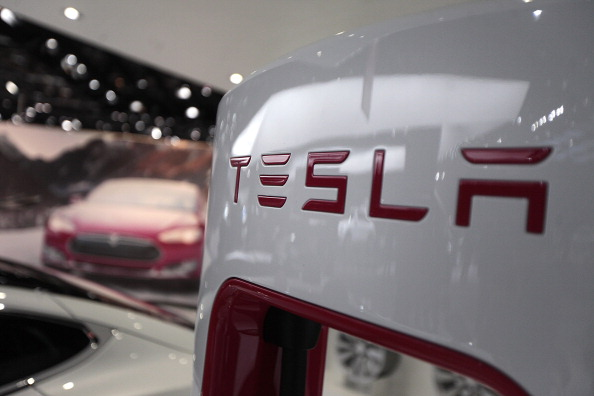 The Tesla Motors Inc. logo is seen during the 2014 North American International Auto Show.