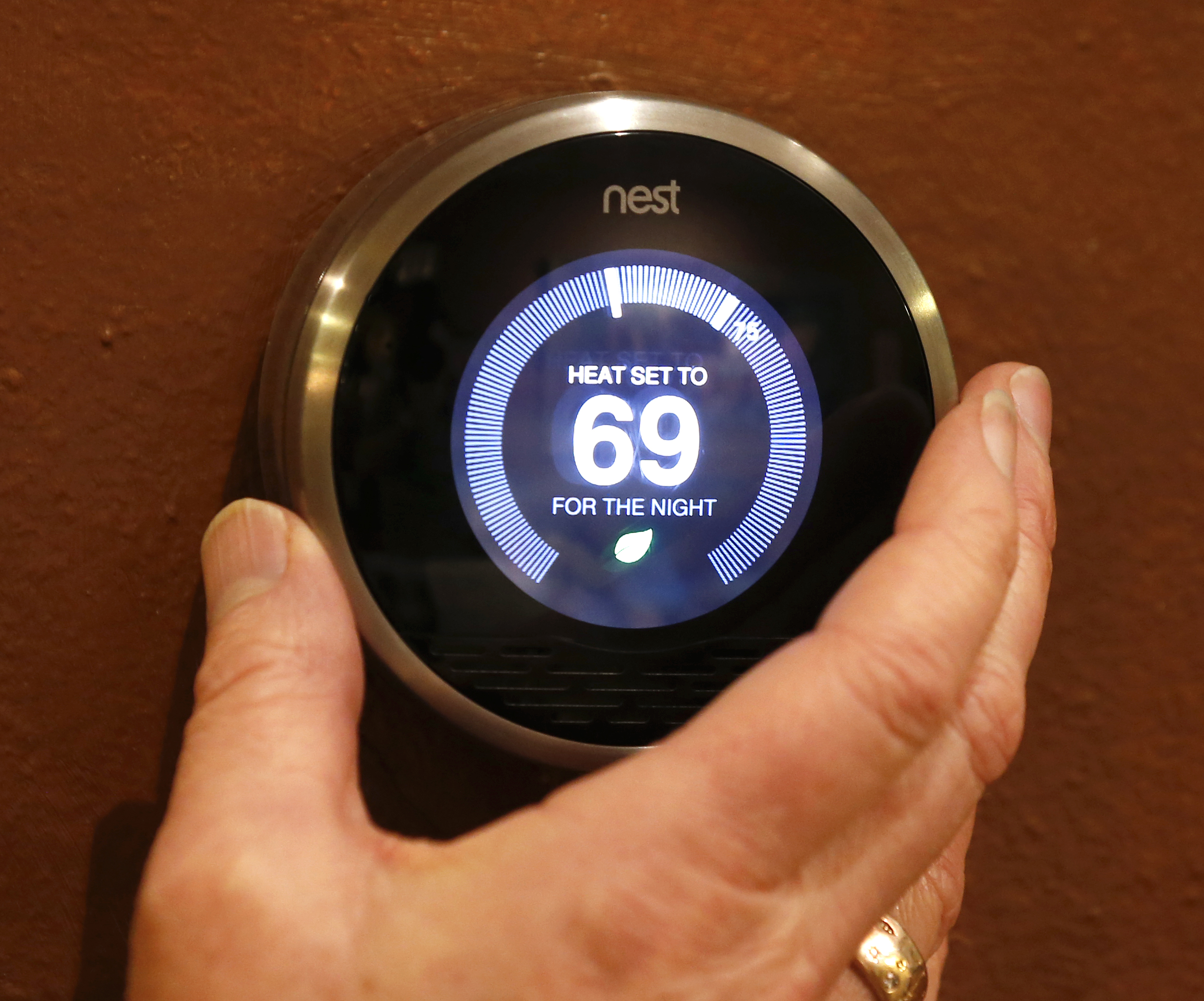 In this photo illustration, a Nest thermostat is being adjusted in a home on January 16, 2014 in Provo, Utah.