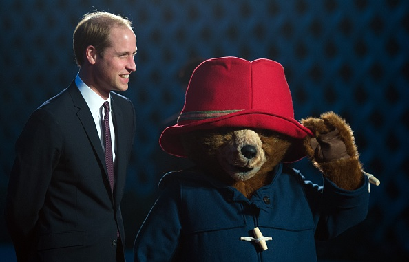Britain's Prince William poses next to a person wearing a Paddington Bear costume prior to the screening of the Paddington movie in Shanghai on March 3, 2015