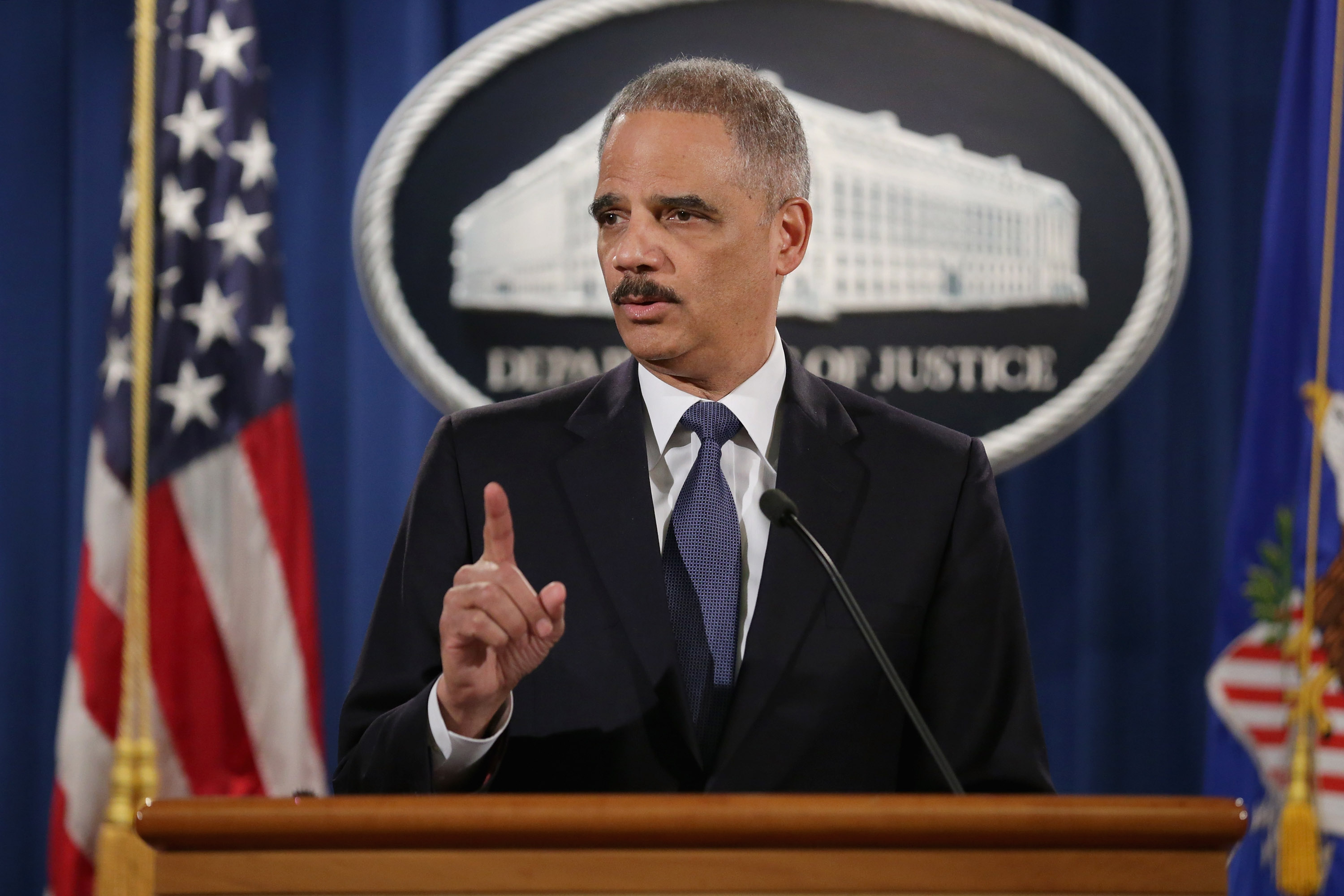 Attorney General Eric Holder delivers remarks about the Justice Department's findings related to two investigations in Ferguson, Missouri, at the Robert F. Kennedy Department of Justice Building March 4, 2015 in Washington, DC.