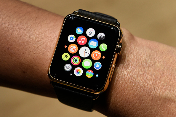 An attendee displays the Apple Watch Edition during the Apple Inc. Spring Forward event in San Francisco, Calif. on March 9, 2015.