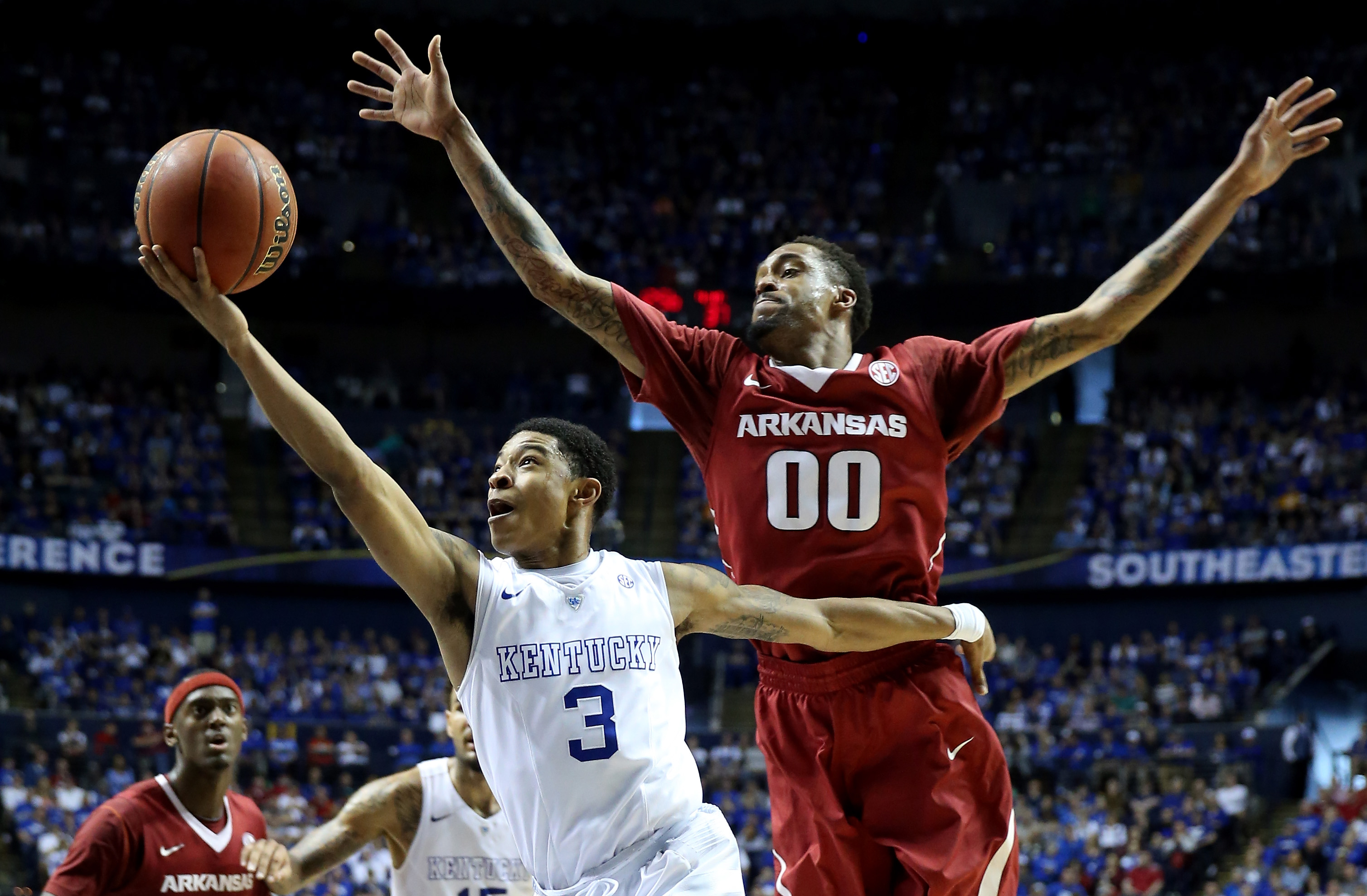 Tyler Ulis #3 of the Kentucky Wildcats goes to the basket as Rashad Madden #00 of the Arkansas Razorbacks defends during the championship game of the SEC basketball tournament at Bridgestone Arena on March 15, 2015 in Nashville, Tennessee.