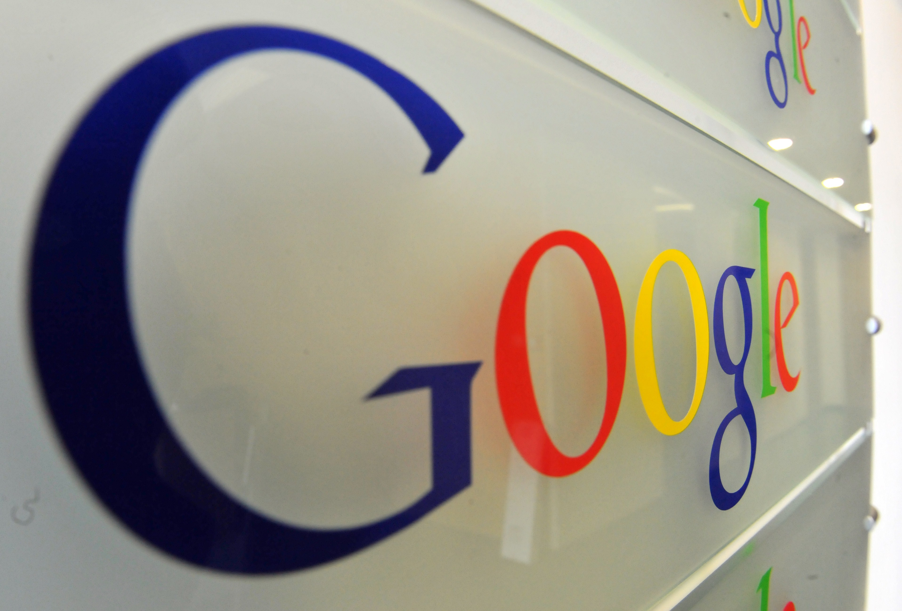 Google logo is seen on a wall at the entrance of the Google offices in Brussels on February 5, 2014.