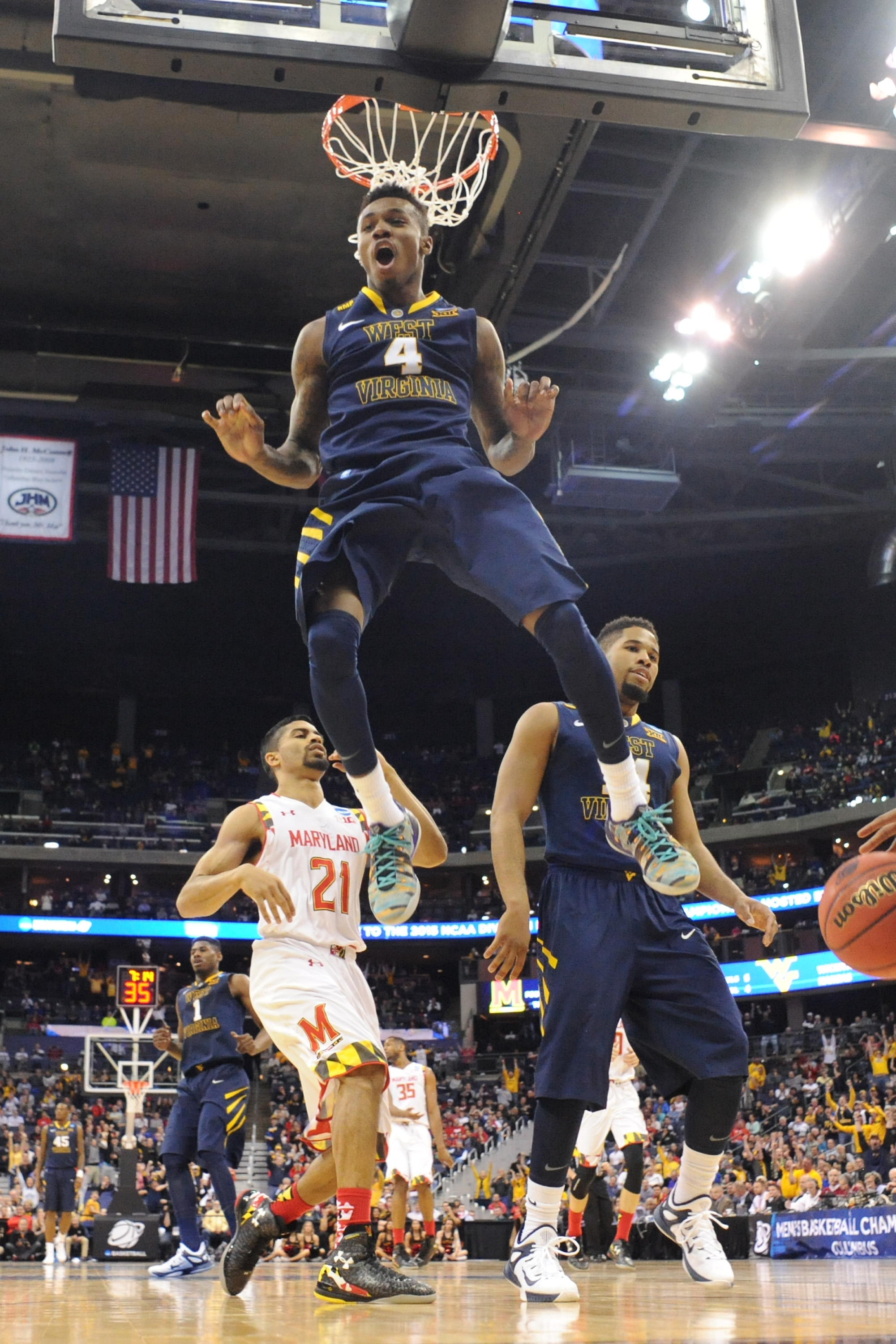 Daxter Miles Jr. #4 of the West Virginia Mountaineers reacts after dunking the ball during the third round of the 2015 NCAA Men's Basketball Tournament on March 22, 2015 at Nationwide Arena in Columbus, Ohio.