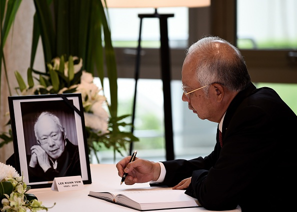 Malaysian Prime Minister Najib Razak signs a condolence book for Singapore's former prime minister Lee Kuan Yew (pictured L) at Singapore's High Commission in Kuala Lumpur on March 24, 2015. Singapore's first prime minister Lee Kuan Yew, one of the towering figures of post-colonial Asian politics, died at the age of 91 on March 23 in a Singapore hospital.      AFP PHOTO / MANAN VATSYAYANA        (Photo credit should read MANAN VATSYAYANA/AFP/Getty Images)