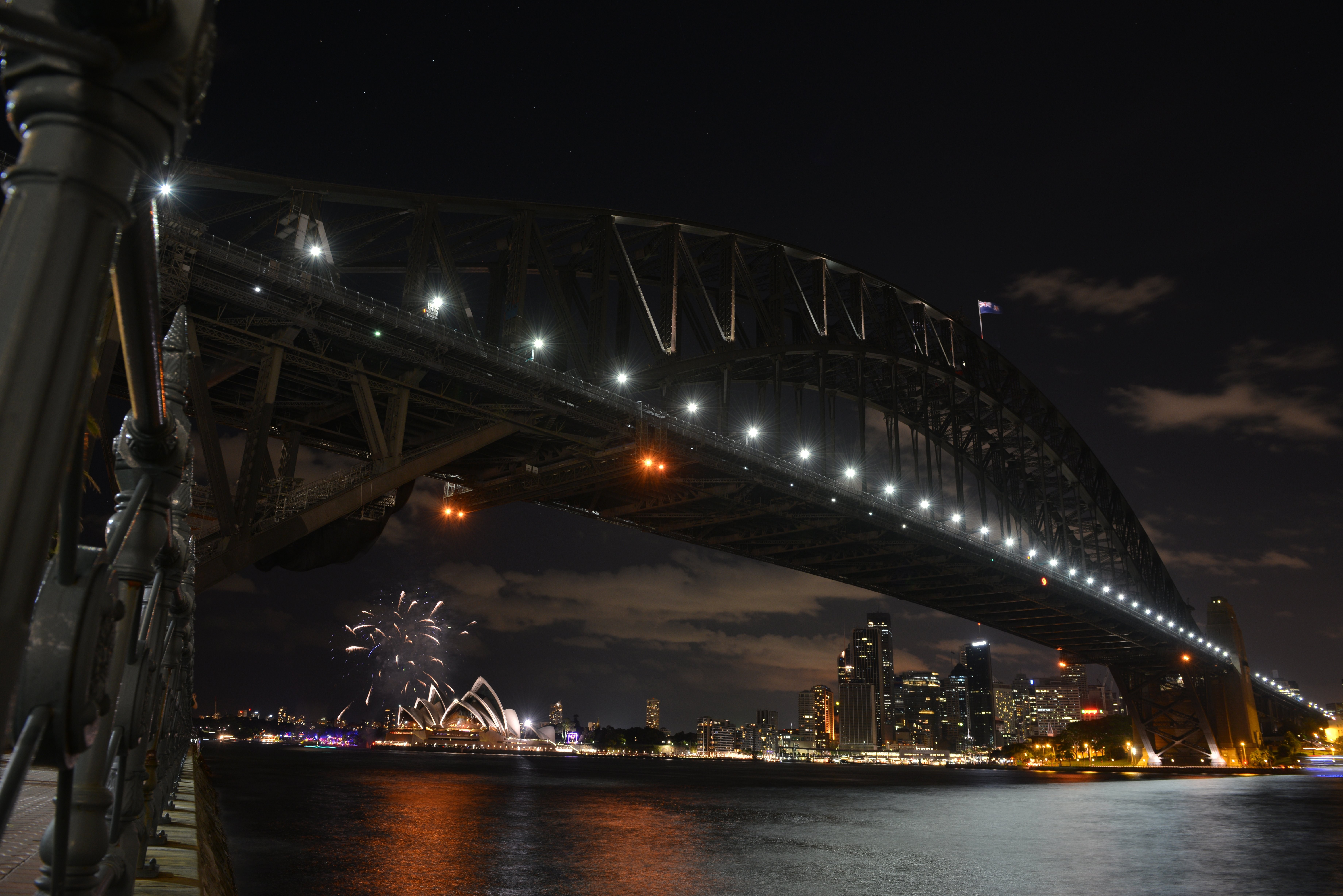Fireworks fade as lights go out on the Sydney Harbour Bridge and Opera House to signal the start of the Earth Hour environmental campaign, among the first landmarks around the world to dim their lights for the event on March 28, 2015.
