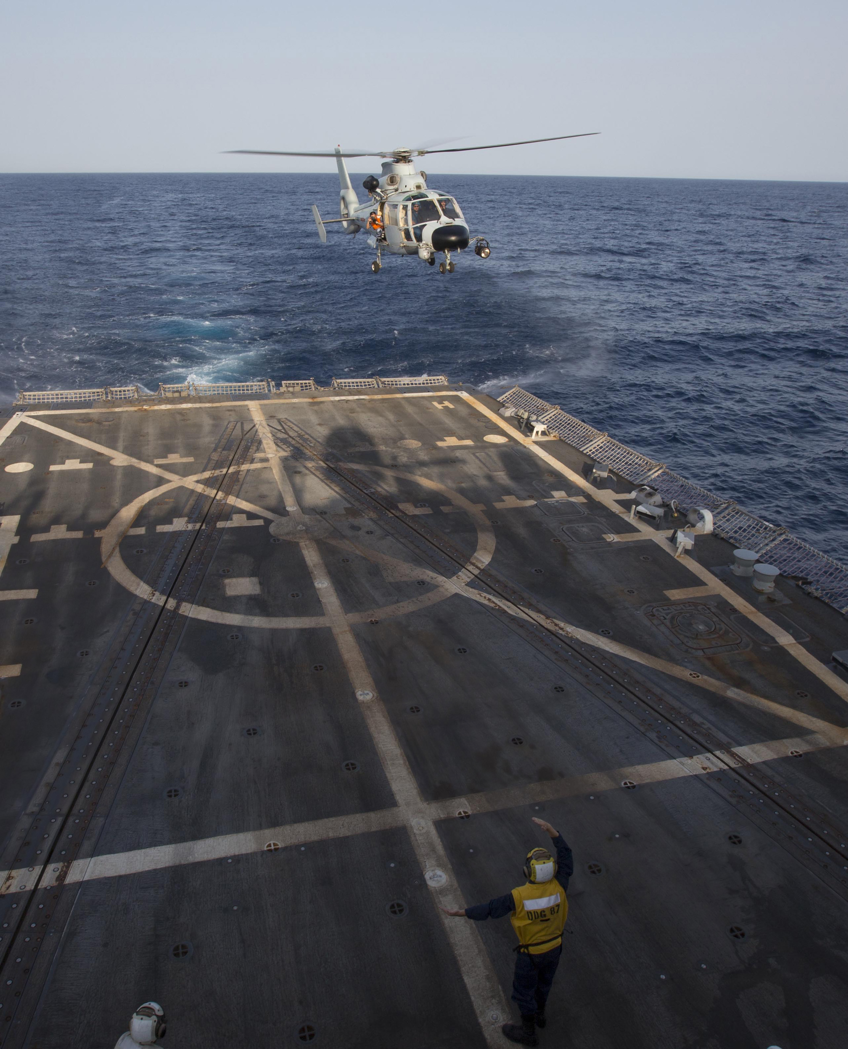 A Chinese Harbin Z-9C helicopter lands aboard U.S.S. Mason