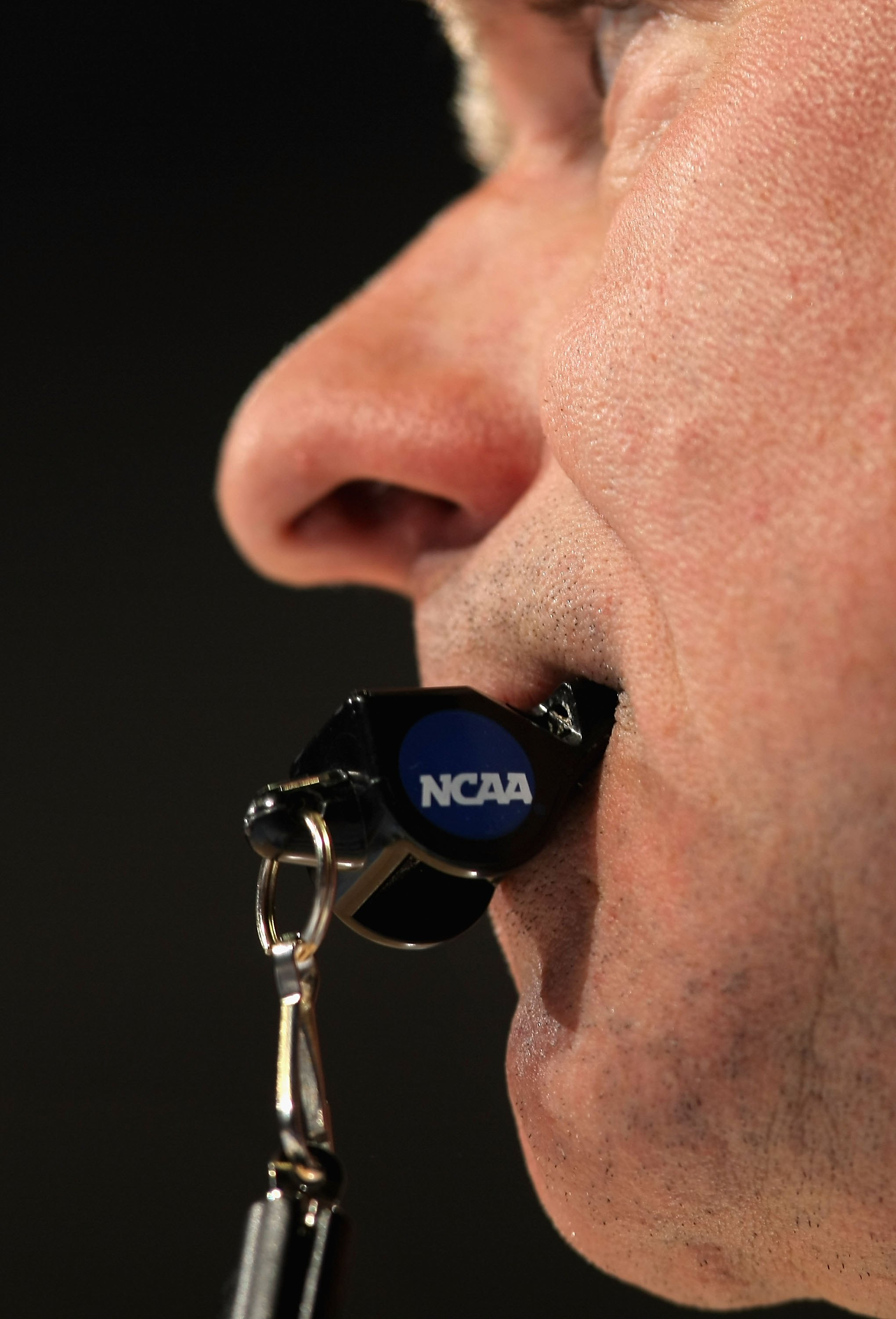 A referee holds his whistle during the second round game of the South Regional between the Pittsburgh Panthers and the Michigan State Spartans on March 22, 2008 in Denver, Colorado.