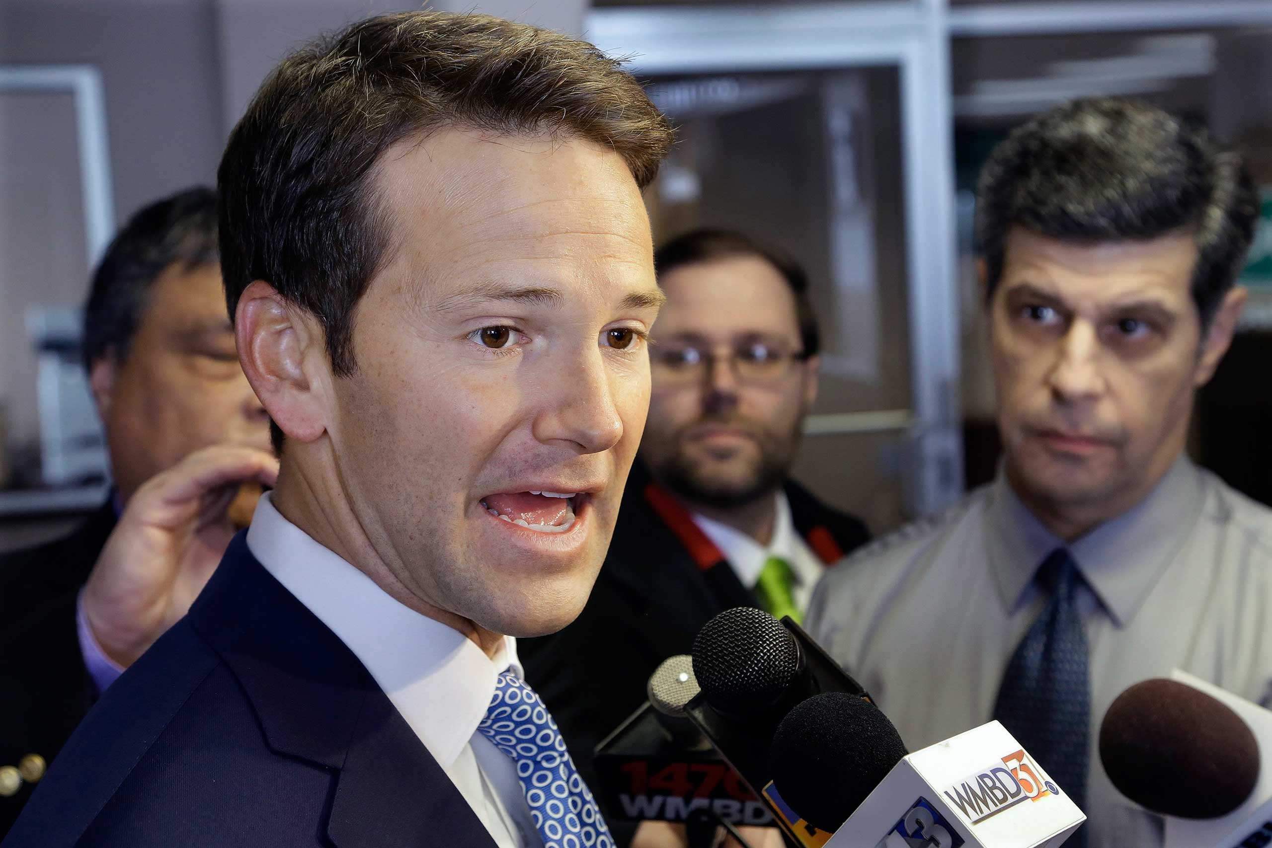 Rep. Aaron Schock, R-Ill. speaks to reporters in Peoria Ill. on Feb. 2, 2015.