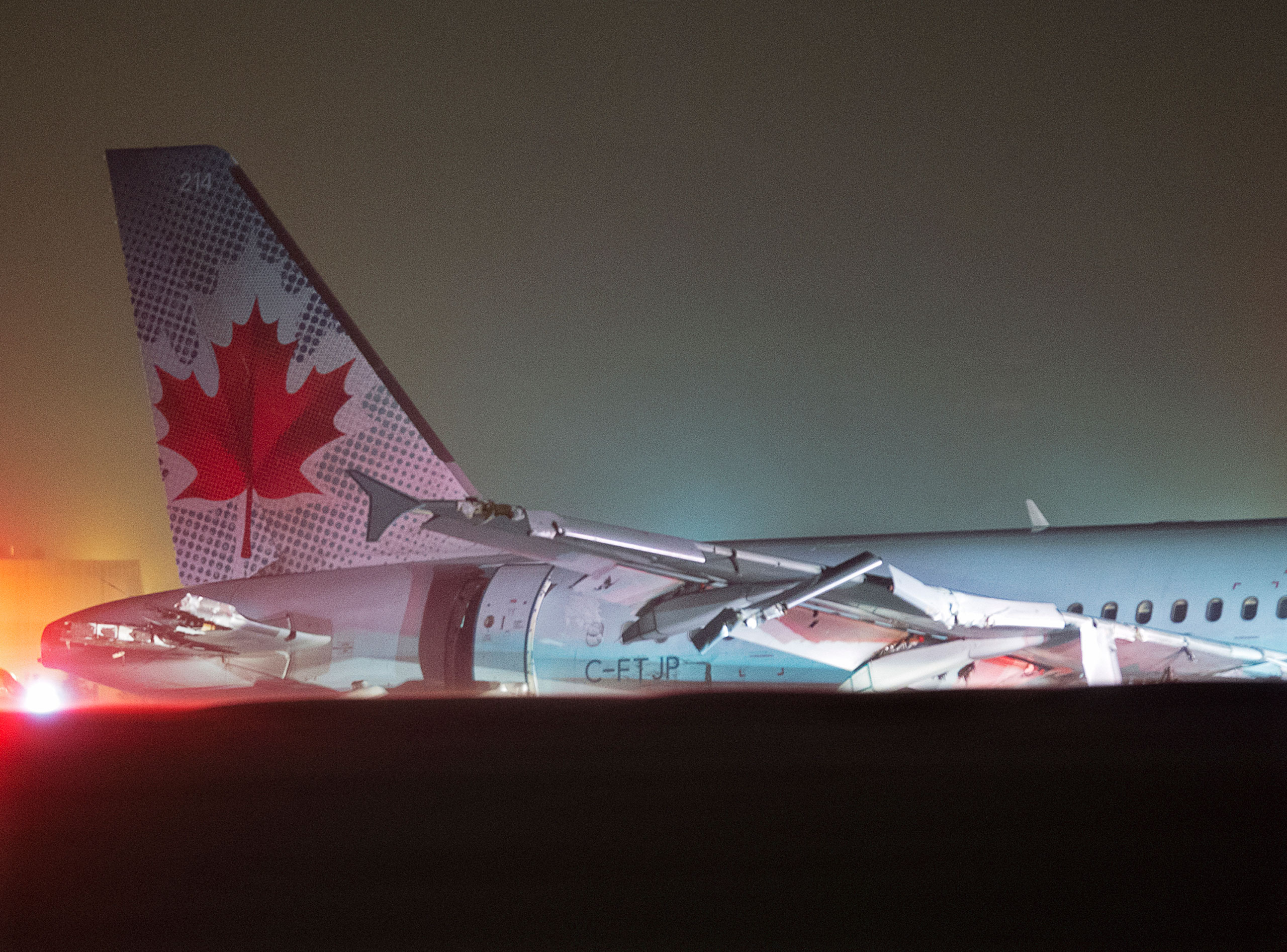 Air Canada flight 624 rests off the runway after landing at Stanfield International Airport in Halifax, Canada on, March. 29, 2015.