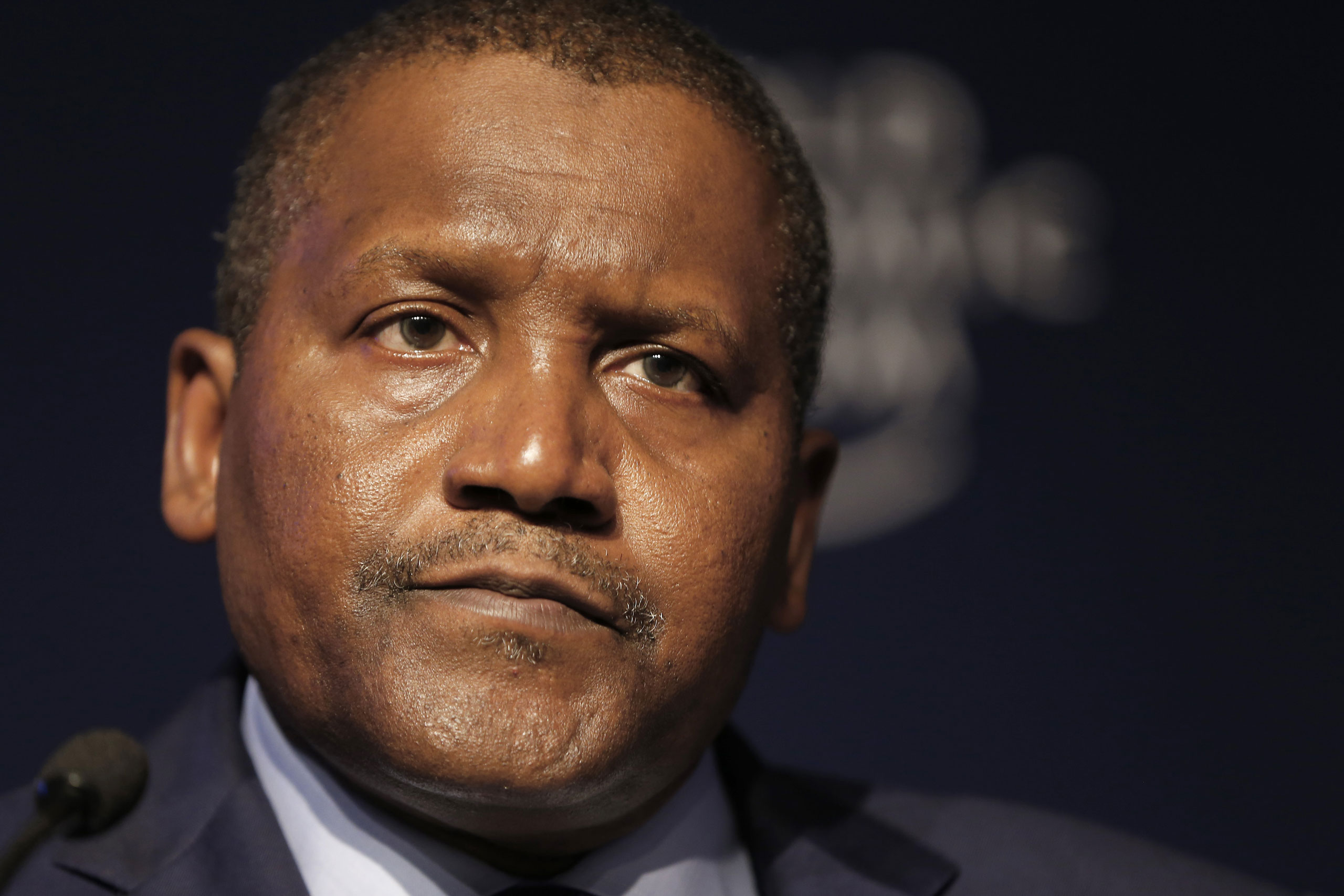 Aliko Dangote, billionaire and chief executive officer of Dangote Group, pauses during a session on day two of the World Economic Forum (WEF) in Davos, Switzerland, Jan. 22, 2015.
