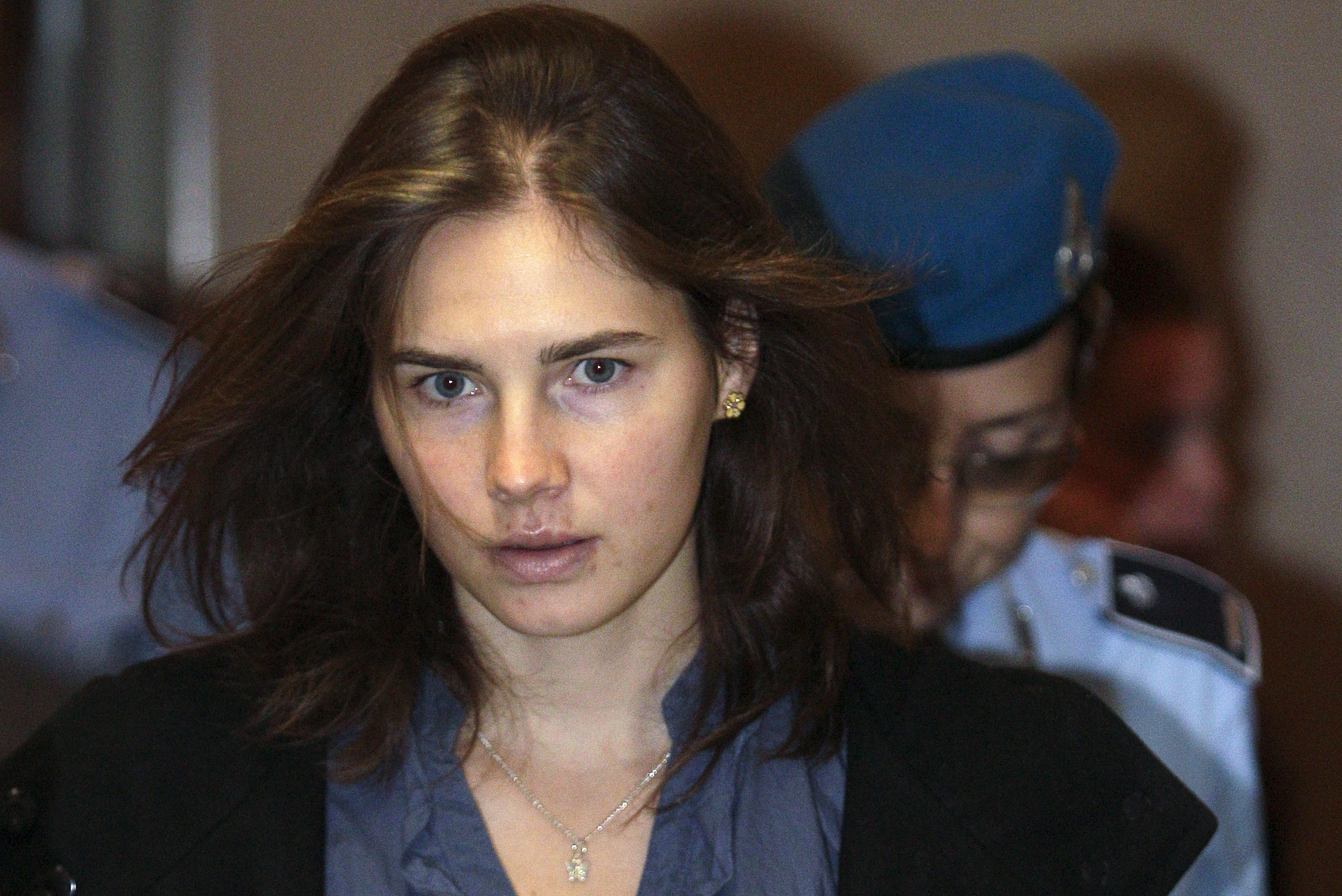 Amanda Knox, the U.S. student convicted of murdering her British flatmate Meredith Kercher in Italy in November 2007, arrives at the court during her appeal trial session in Perugia in this September 30, 2011 file photo.