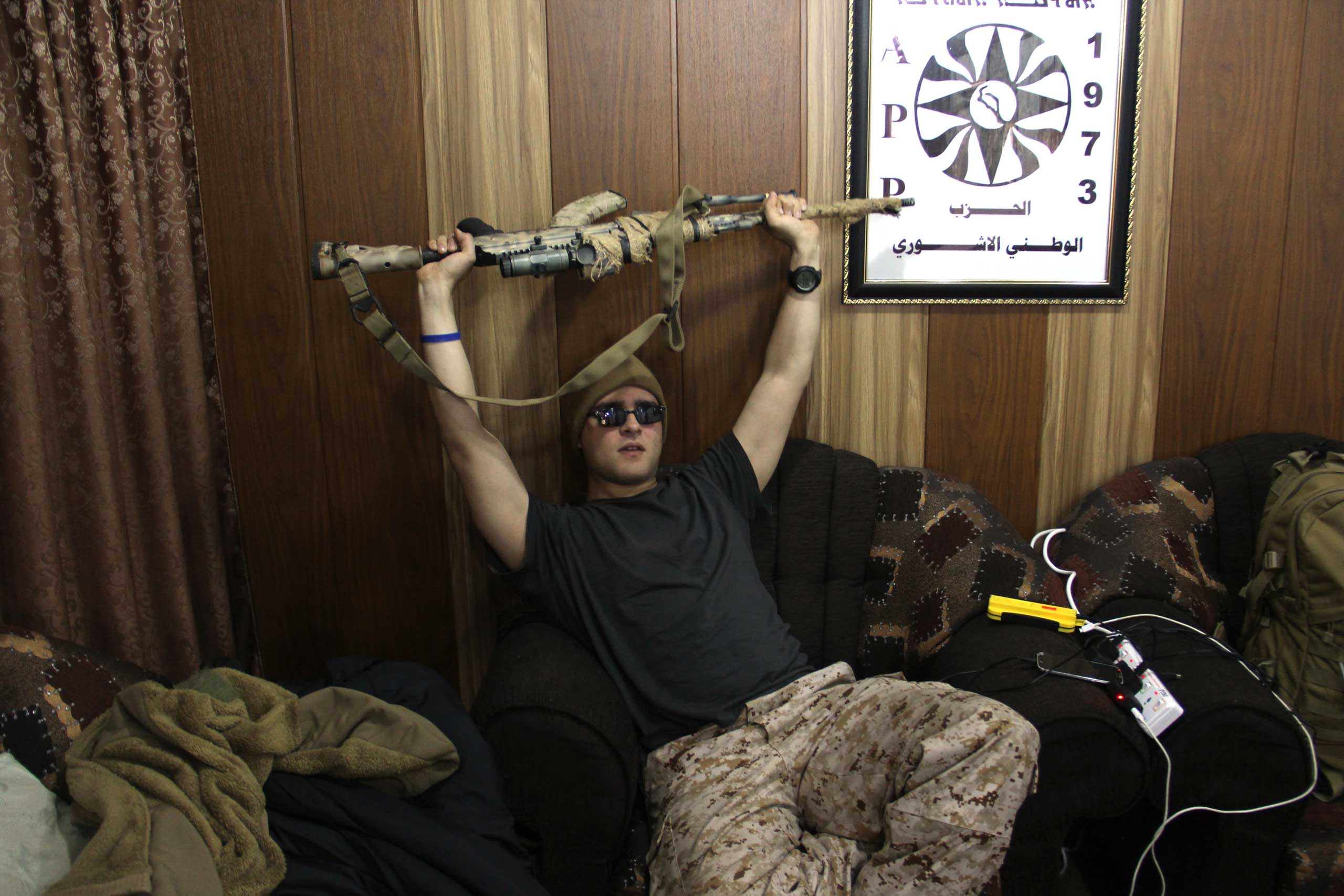 Louis in the living room where the foreign recruits sleep in Dwekh Nawsha headquarters in Dohuk, northern Iraq.