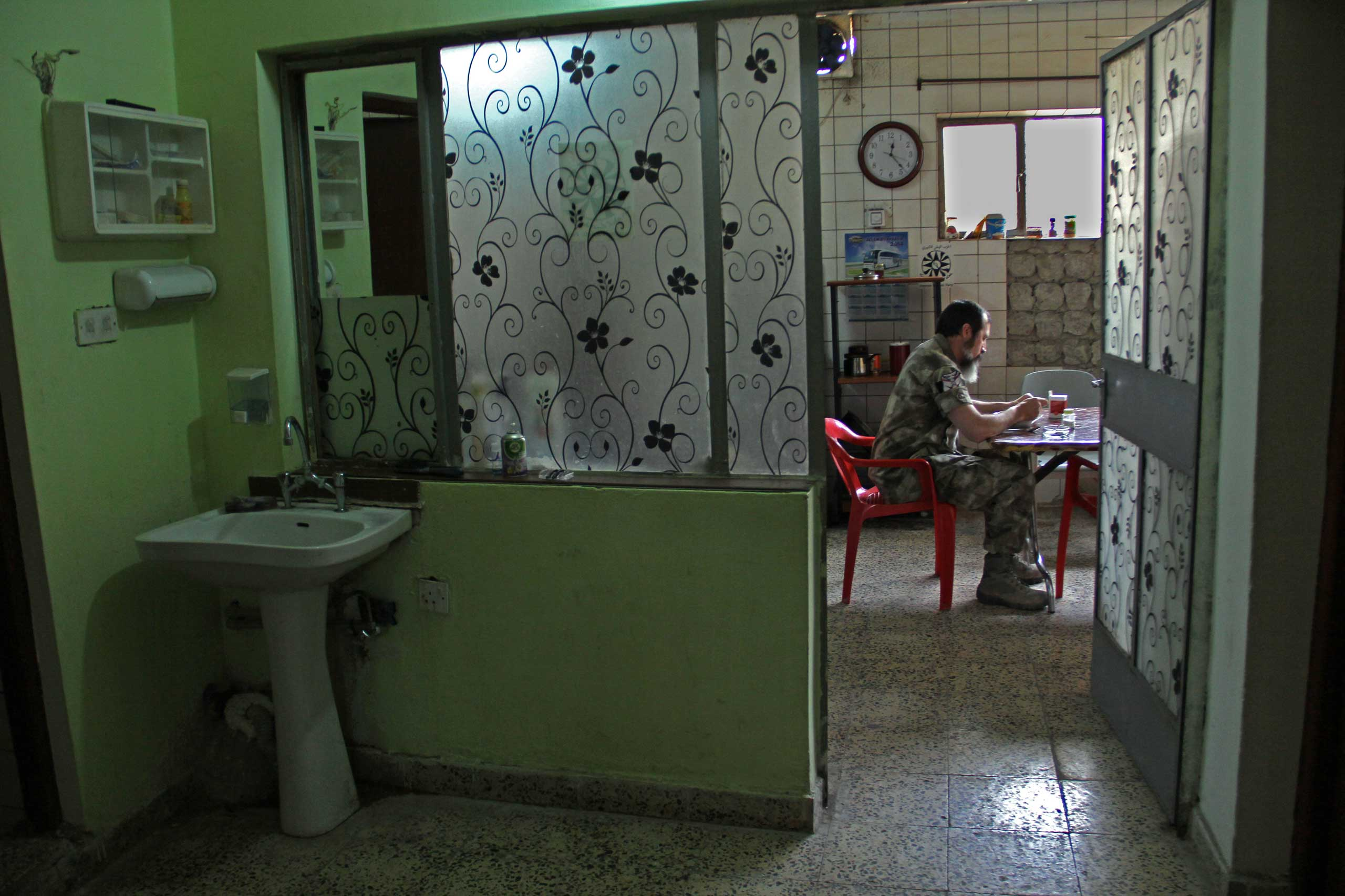 Scott eats lunch in the Dwekh Nawsha headquarters in Dohuk, northern Iraq.