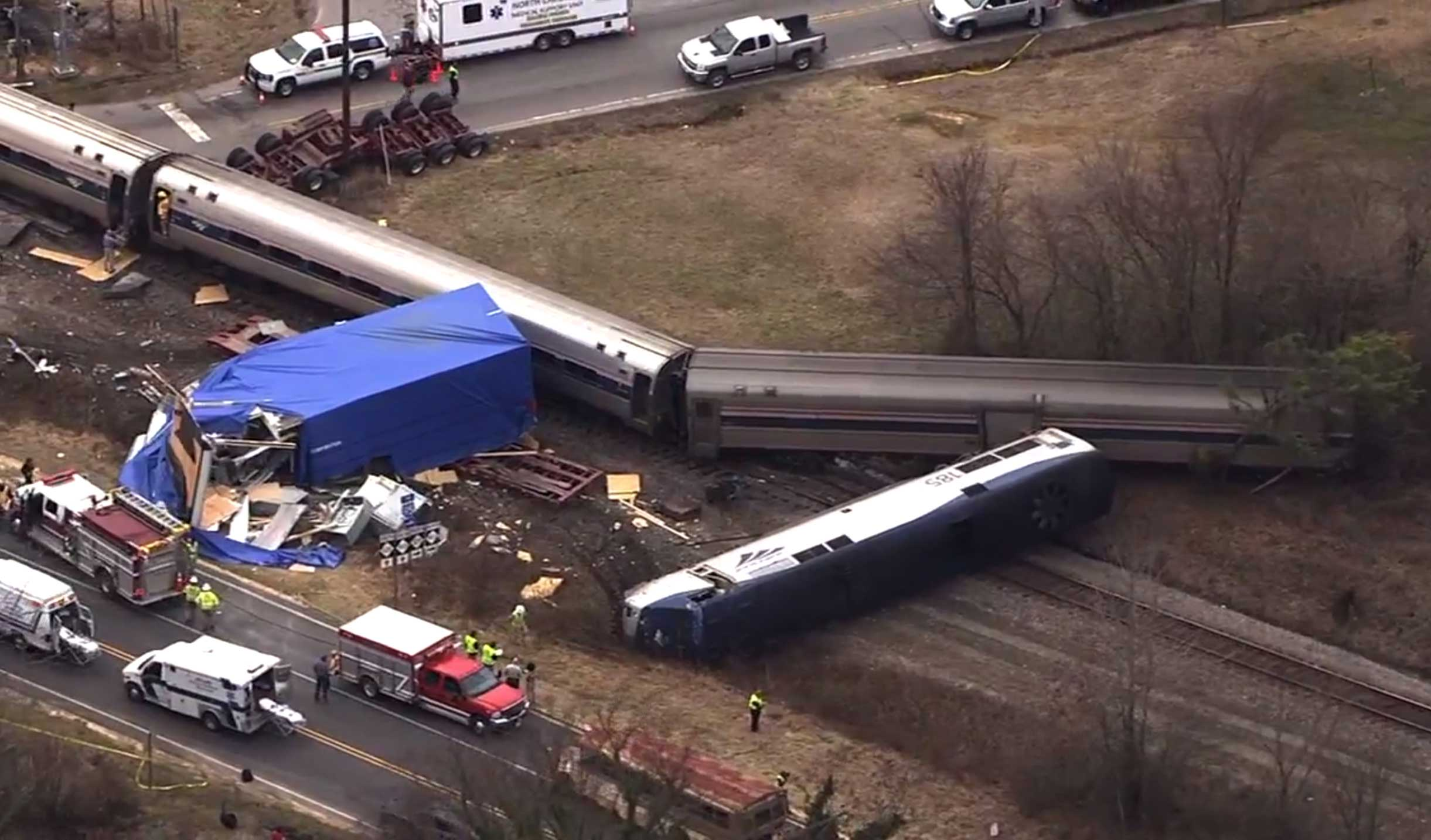 Authorities respond to a collision between an Amtrak passenger train and a truck, Monday, March 9, 2015, in Halifax County, N.C.