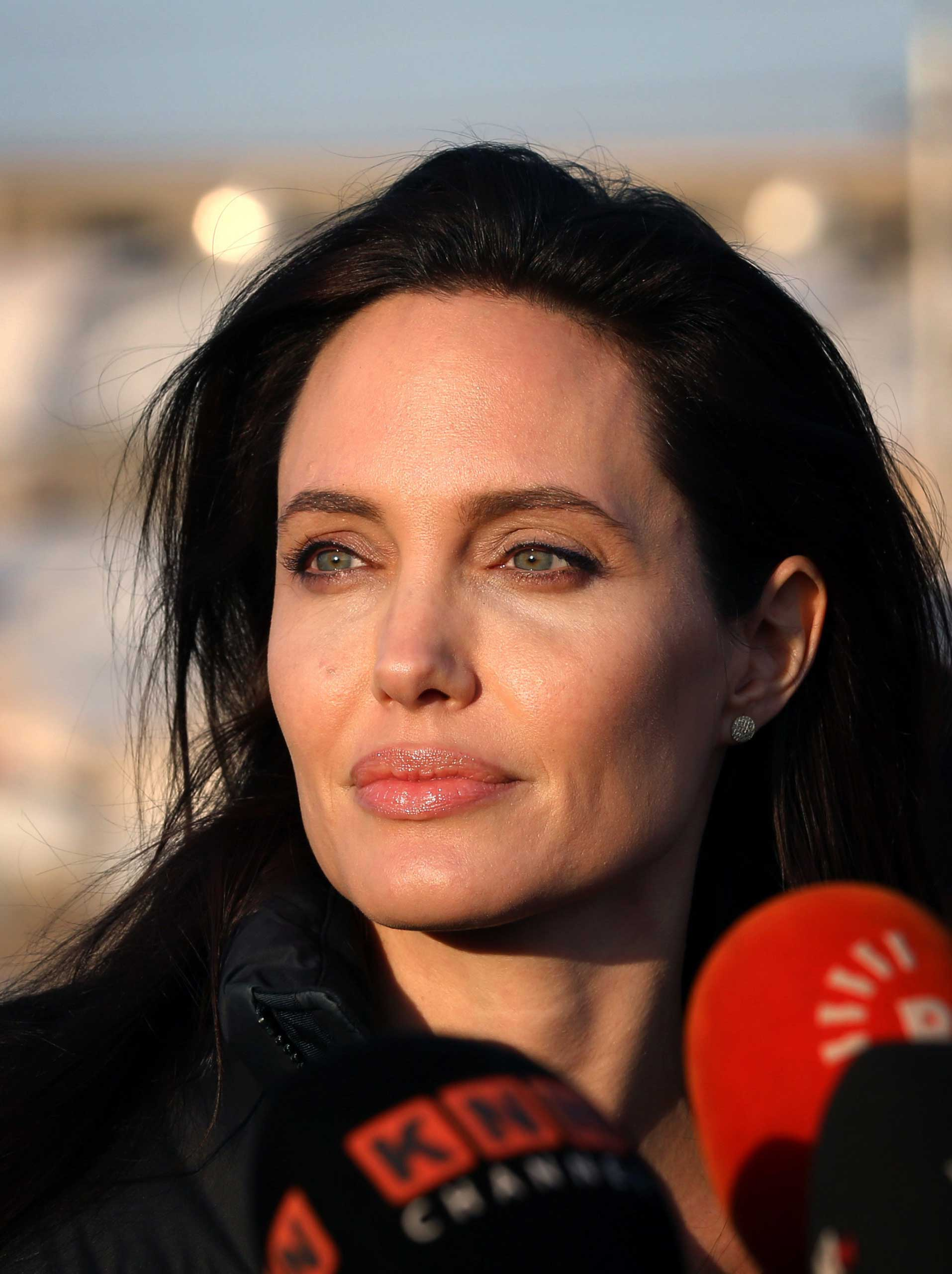Angelina Jolie pauses as she delivers a speech during a visit to a camp for displaced Iraqis in Khanke, a few kilometers from the Turkish border in Iraq's Dohuk province on Jan. 25, 2015.