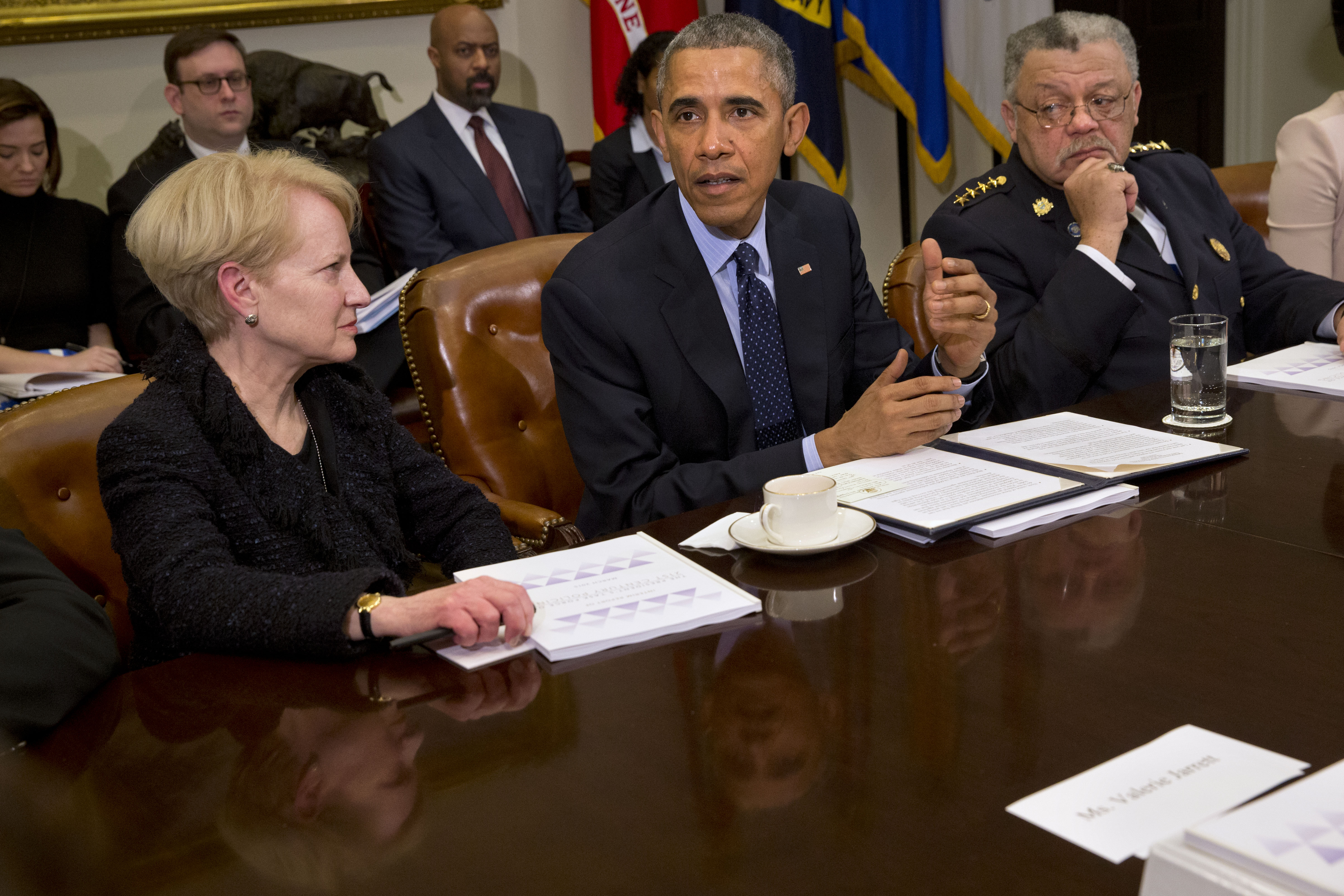President Barack Obama, flanked by former Assistant Attorney General Laurie Robinson, left, and Philadelphia Police Commissioner Charles Ramsey, speaks during a meeting with members of the Task Force on 21st Century Policing