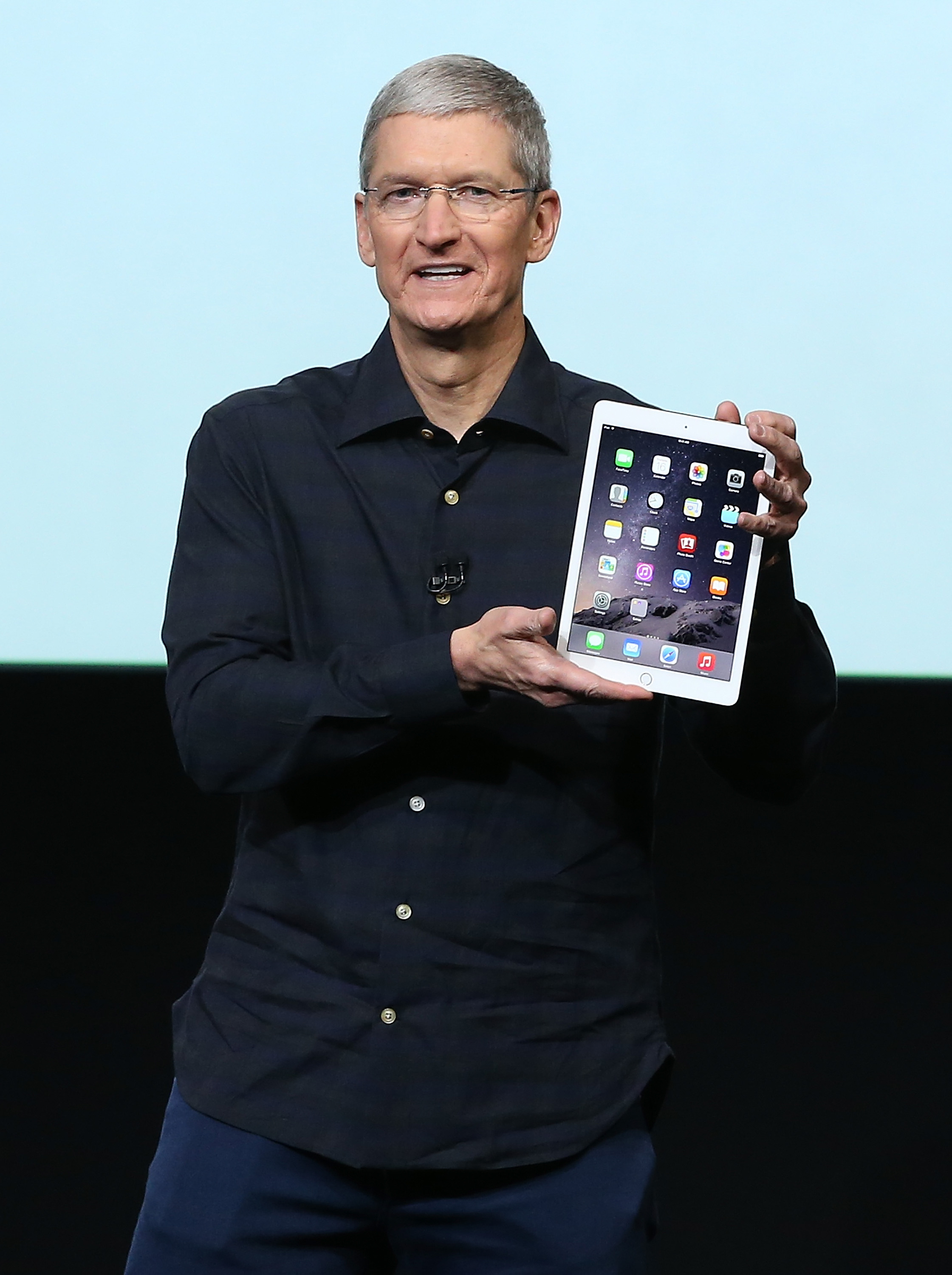Apple CEO Tim Cook holds the new iPad Air 2 during a special event on Oct. 16, 2014 in Cupertino, Calif.