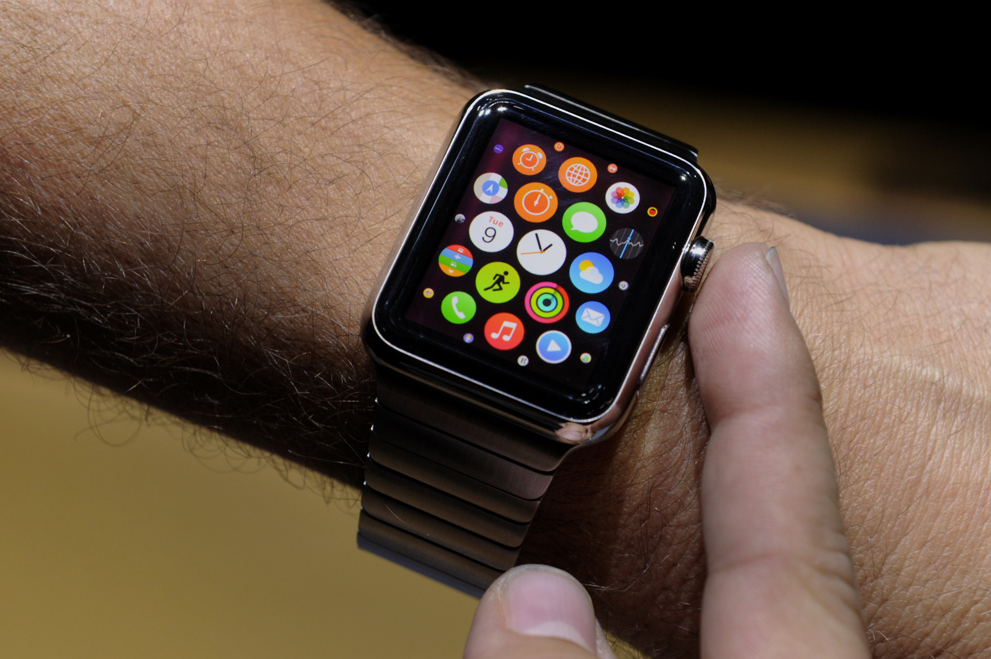 An attendee demonstrates the Apple Watch after a product announcement at Flint Center in Cupertino, Calif, on Sept. 9, 2014.