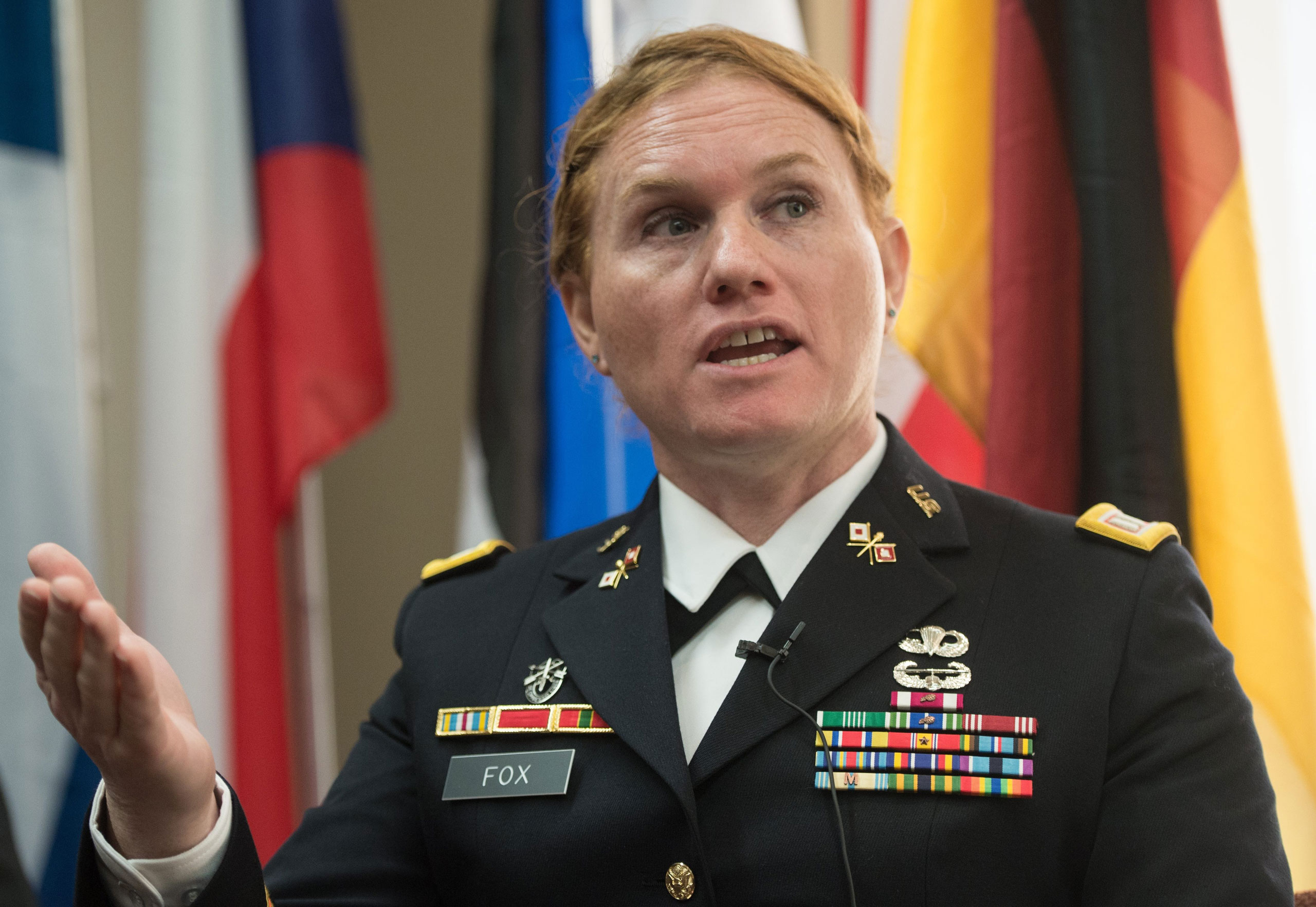 Transgender US Army Reseve Captain Sage Fox speaks during a conference entitled  Perspectives on Transgender Military Service from Around the Globe  organized by the American Civil Liberties Union (ACLU) and the Palm Center in Washington on October 20, 2014. Transgender military personnel from 18 countries who allow them to serve openly,  gathered to talk about their experiences and discuss whether the US military could join them. After Separtating from the military as a man, Fox legally changed her gender, and was invited to join the reserves as a woman.  AFP PHOTO/Nicholas KAMM        (Photo credit should read NICHOLAS KAMM/AFP/Getty Images)