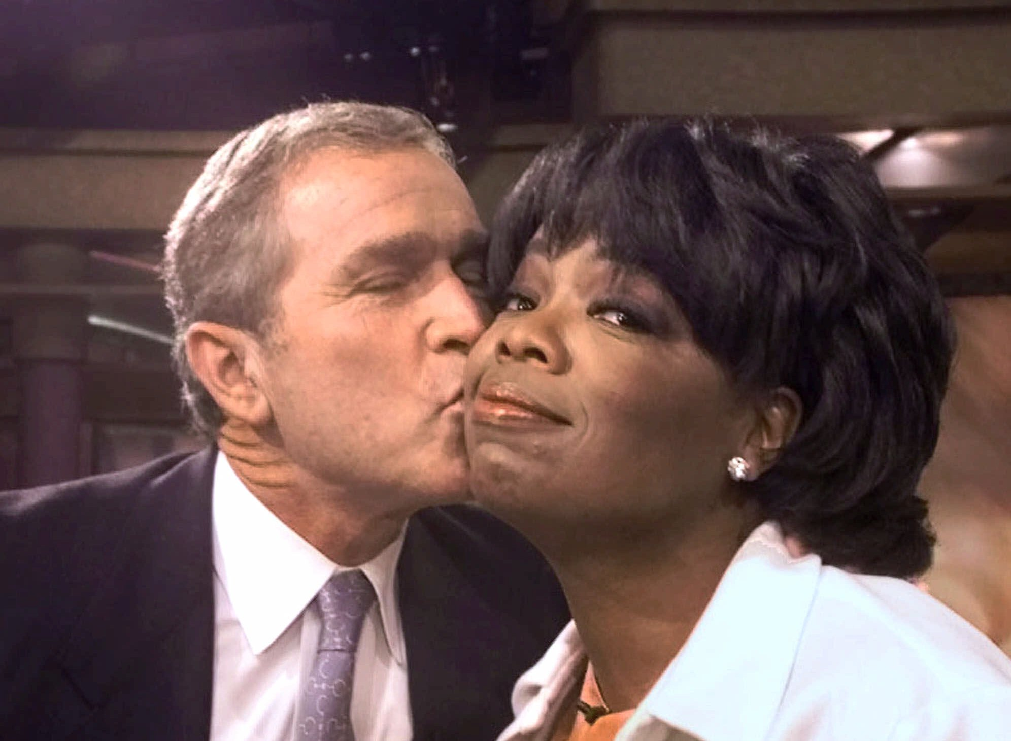 Republican presidential candidate Texas Gov. George W. Bush kisses talk show host Oprah Winfrey on Sept. 19, 2000 after appearing on her program in Chicago.