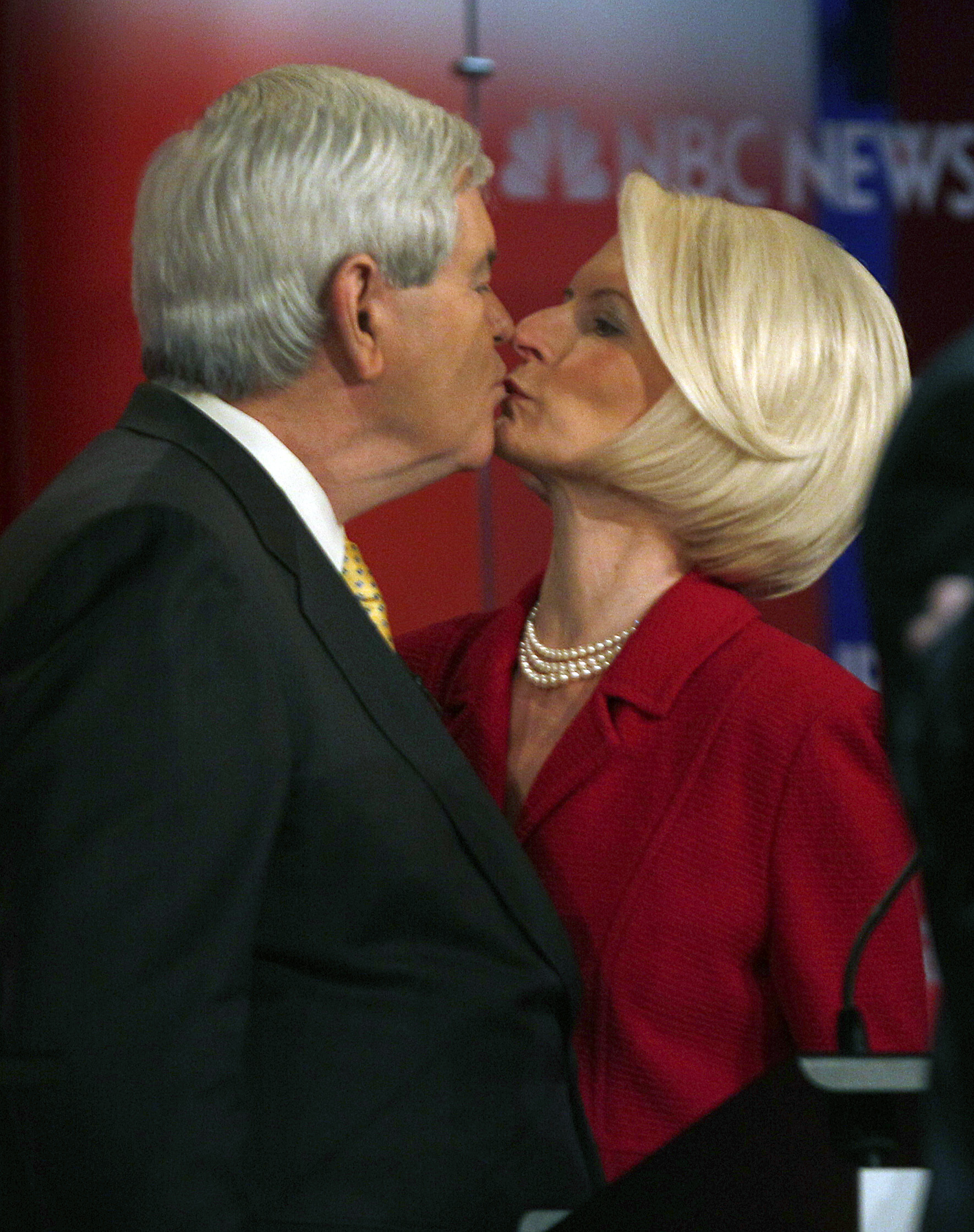 Former House Speaker Newt Gingrich kisses his wife Callista after a Republican presidential candidate debate at the Capitol Center for the Arts in Concord, N.H. on Jan. 8, 2012.