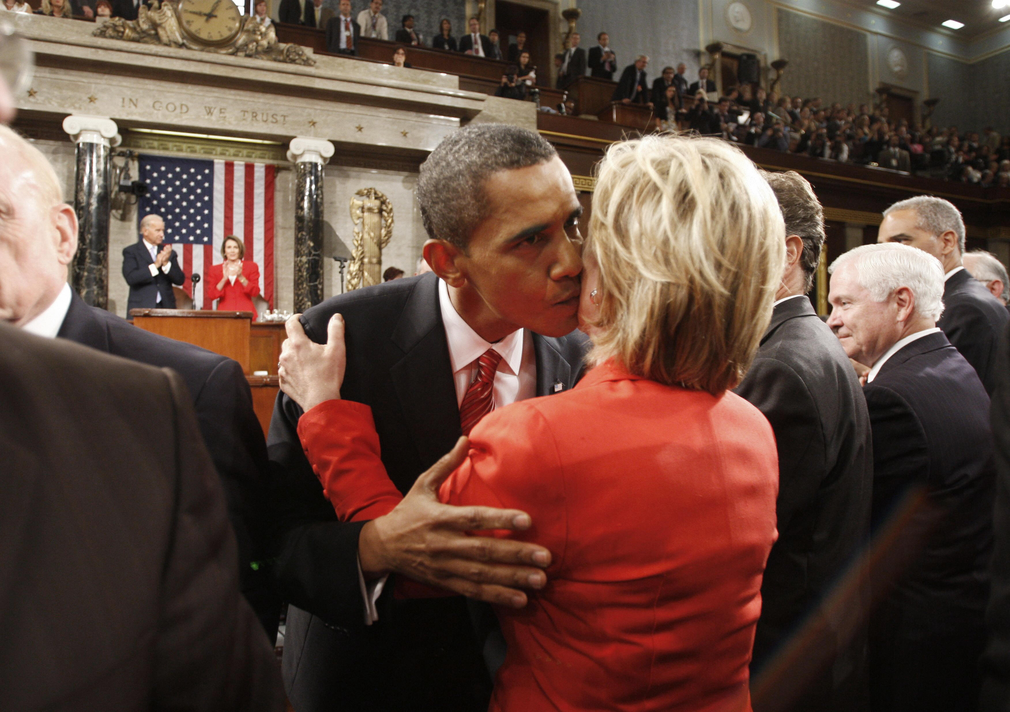 US President Barack Obama kisses US Secretary of State Hillary Clinton after his speech about health care reform before a joint session of Congress on Capitol Hill in Washington, Sept. 9, 2009.