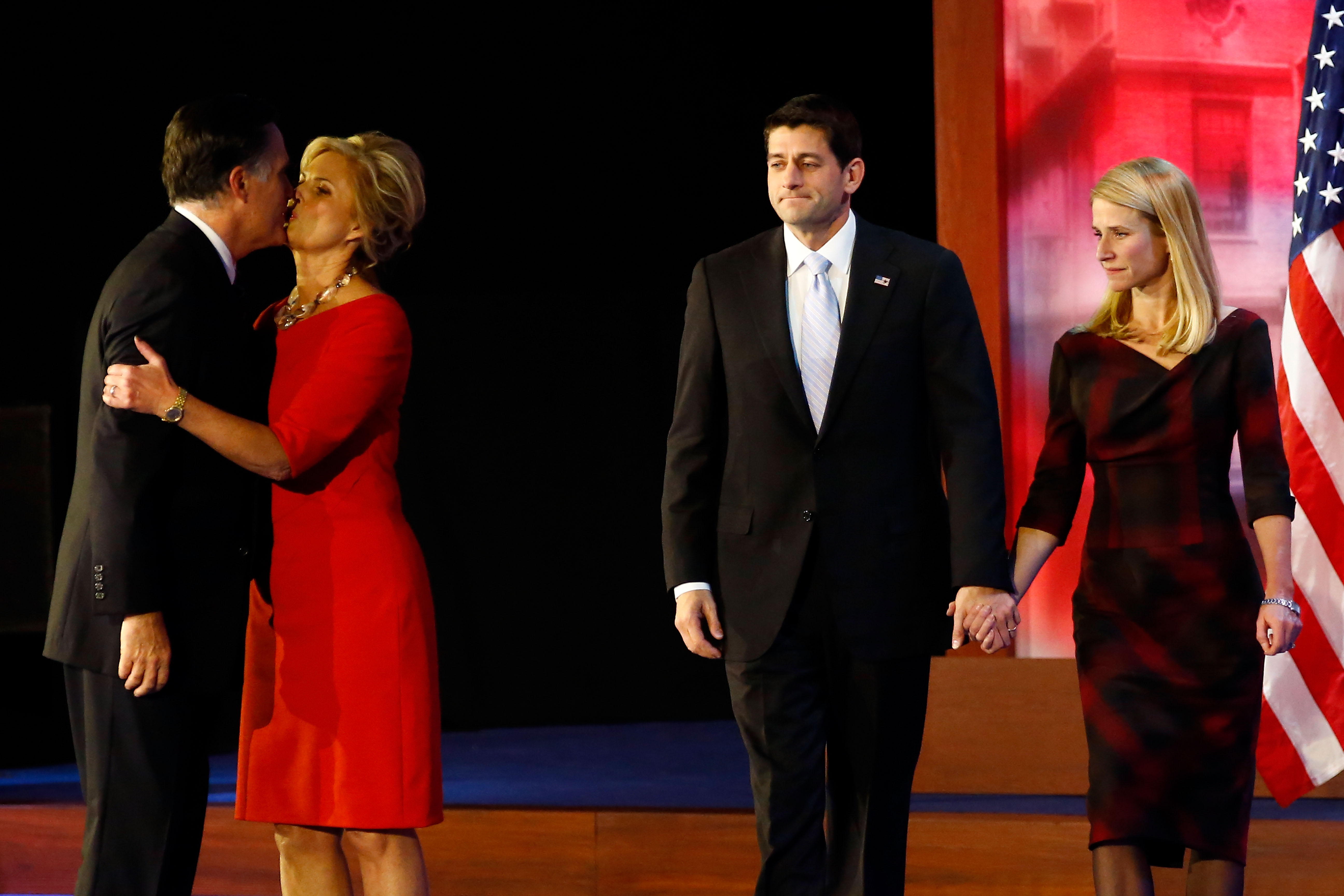 (L-R) Republican presidential candidate, Mitt Romney, kisses his wife, Ann Romney, in front of Republican vice presidential candidate, U.S. Rep. Paul Ryan (R-WI) and wife, Janna Ryan, on stage after conceding the presidency during Mitt Romney's campaign election night event at the Boston Convention—Exhibition Center on Nov. 7, 2012 in Boston.