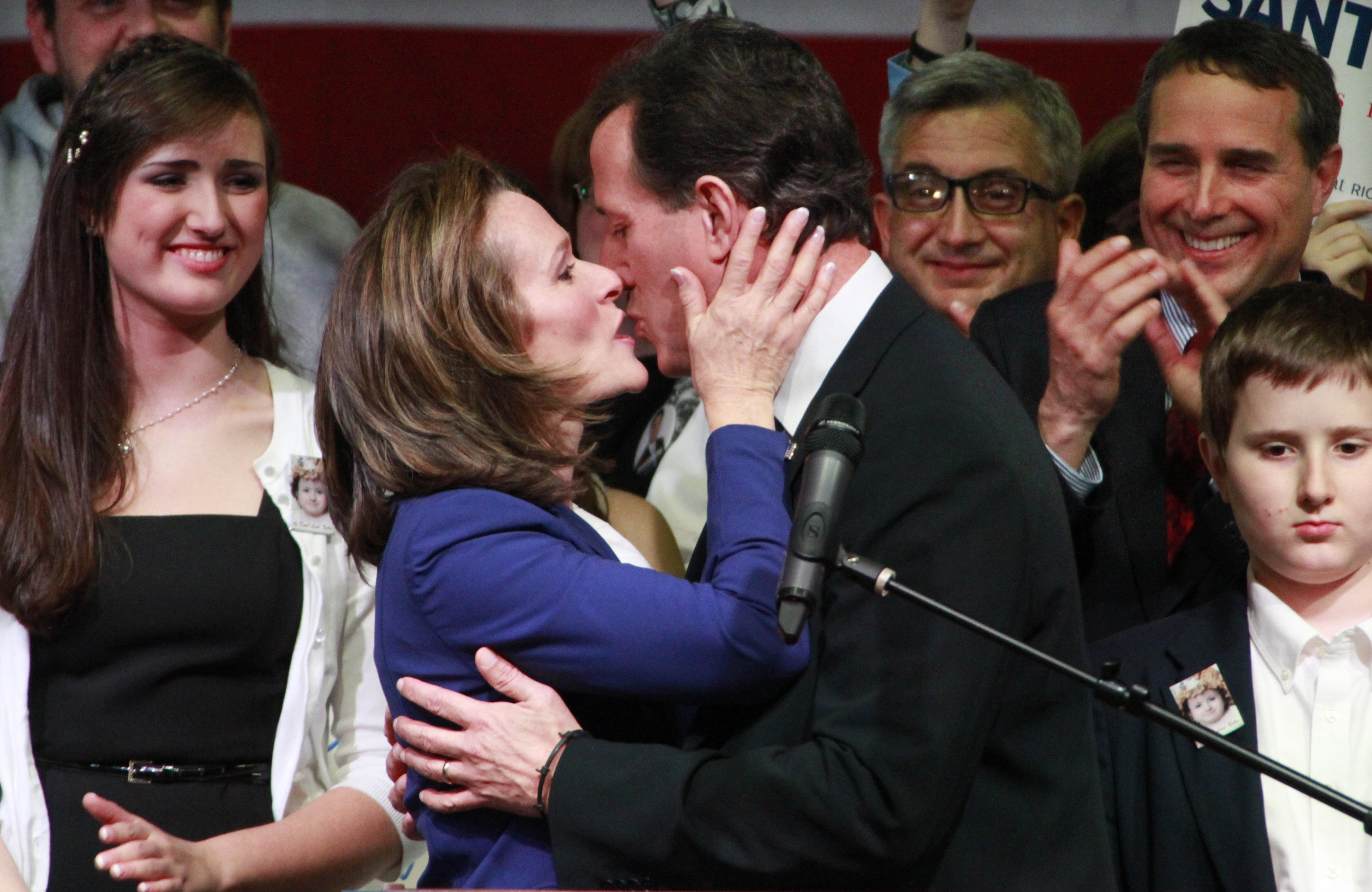 Republican presidential candidate, former Pennsylvania Sen. Rick Santorum kisses his wife Karen before speaking to supporters at an election-night party in the gymnasium of Steubenville High School in Steubenville, Ohio on March 6, 2012.