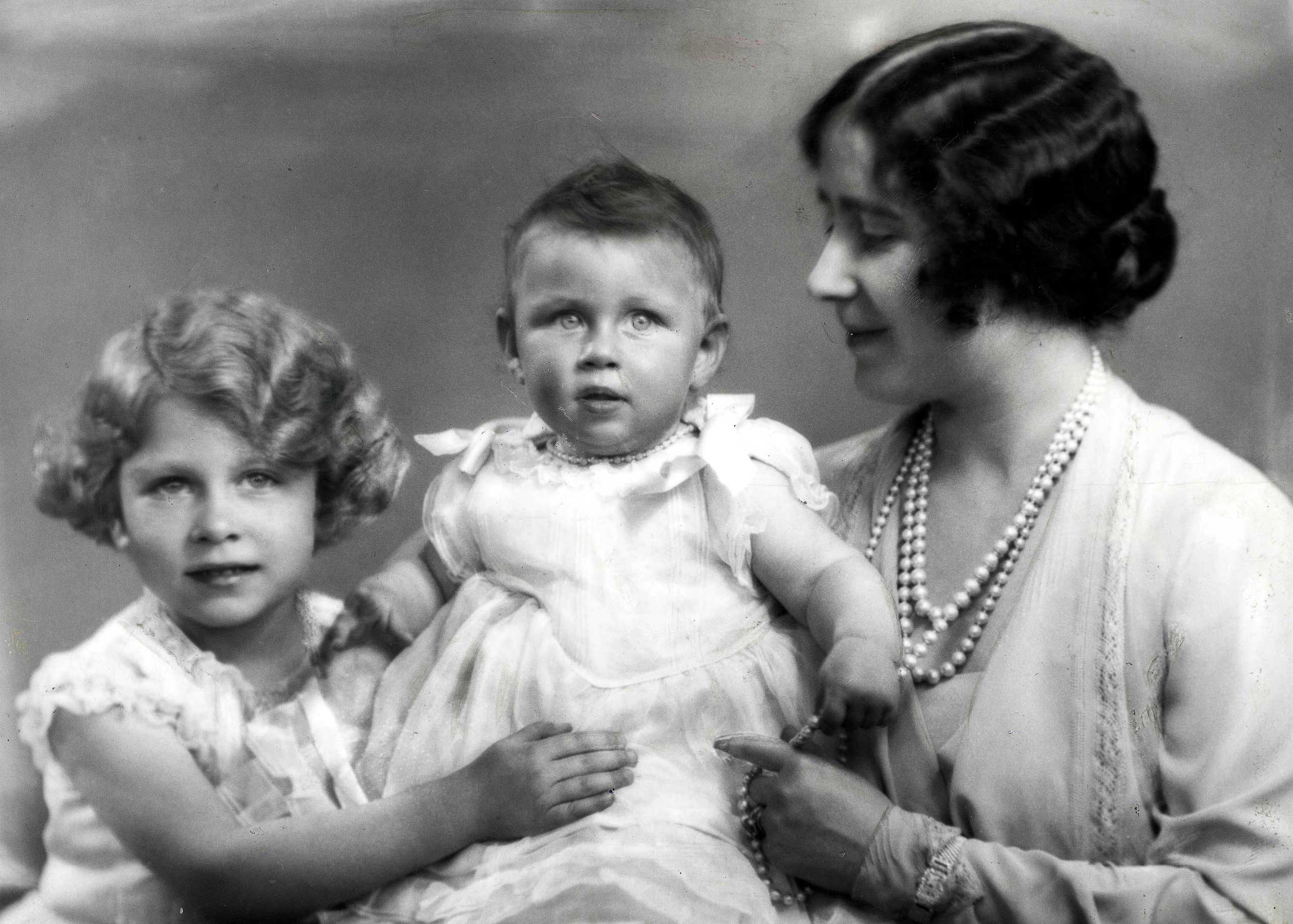 The naughty sister: the baby Princess Margaret, flanked by Princess Elizabeth and their mother, led a colorful life. Prevented from marrying her first love, a divorced commoner, she later married, and divorced, fashionable photographer Antony Armstrong-Jones.