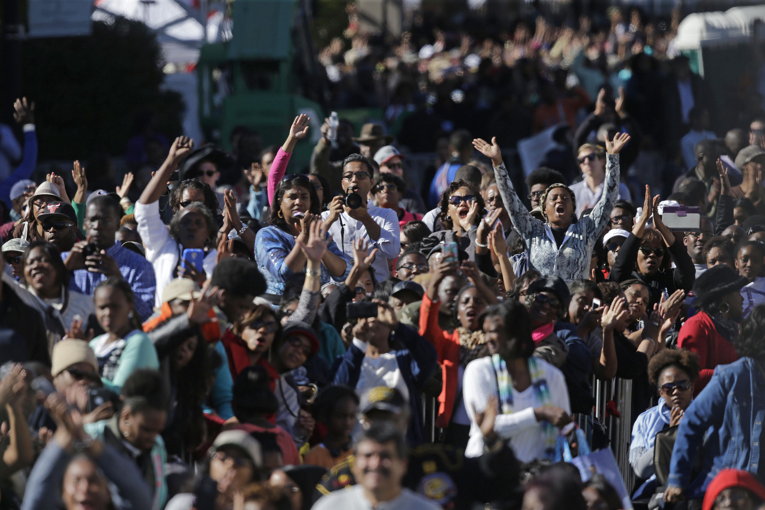 The crowd takes photos and cheer for President Barack Obama as he speaks near the Edmund Pettus Bridge in Selma, Ala. on March 7, 2015.