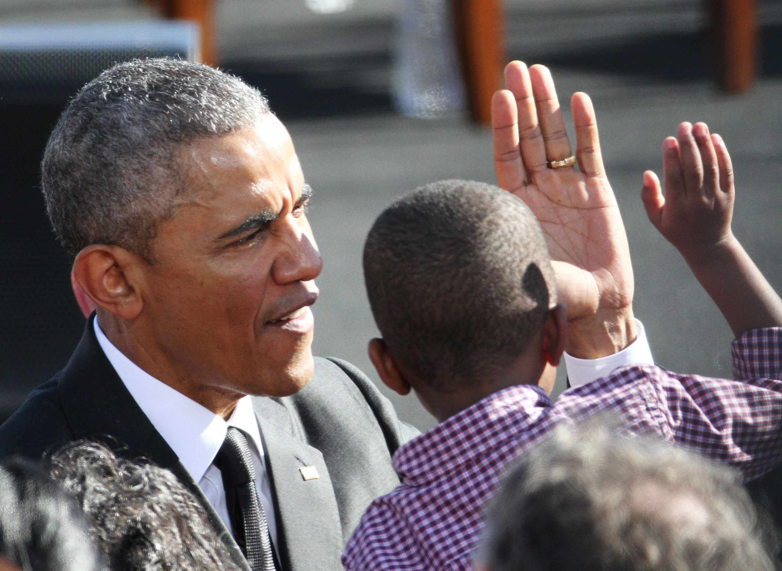 President Barack Obama talks to a young member of the audience after speaking in Selma, Ala. on March 7, 2015.