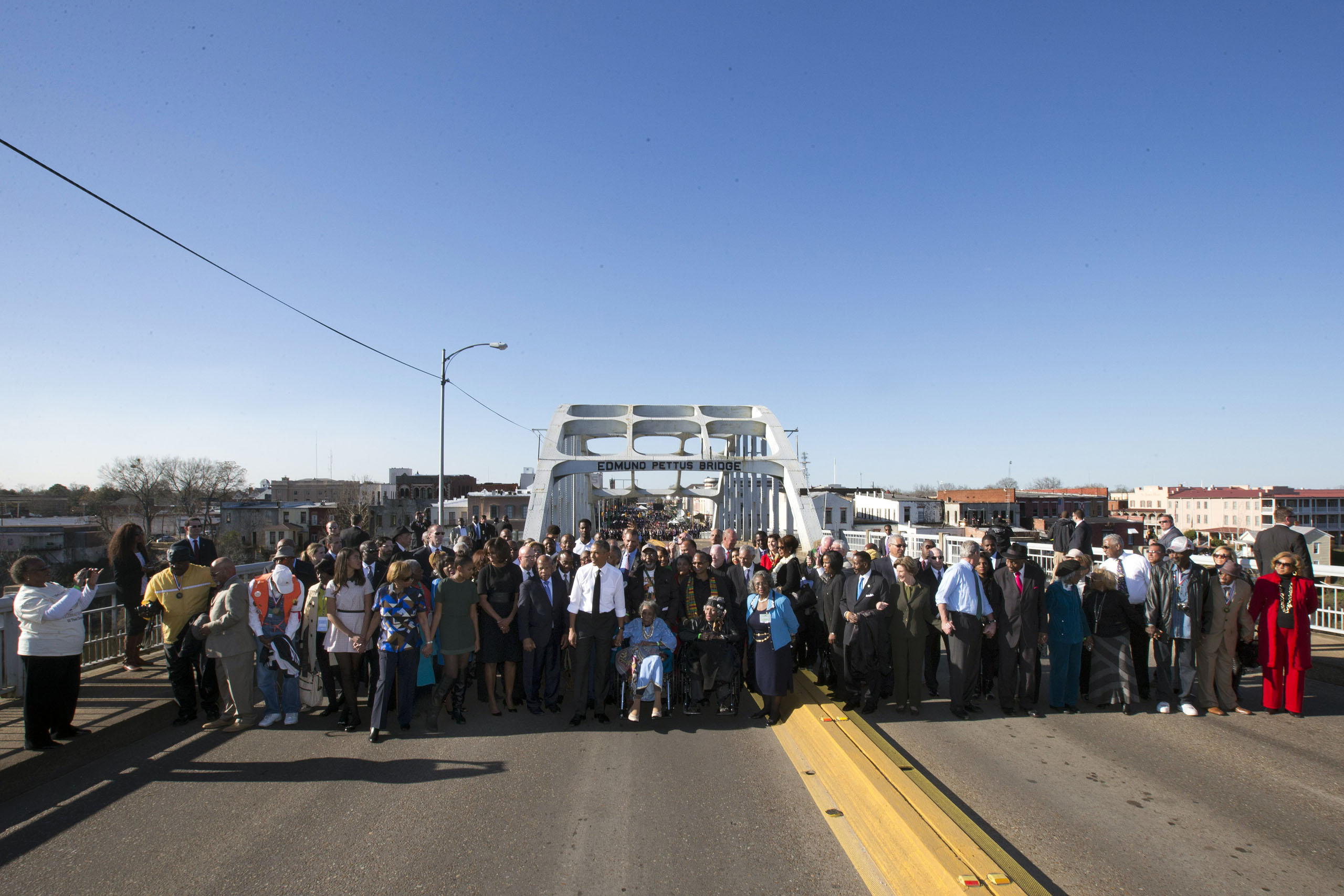 President Barack Obama, first lady Michelle Obama, their daughters Malia and Sasha, as well as members of Congress and civil rights leaders make a symbolic walk across the Edmund Pettus Bridge in Selma, Ala. on March 7, 2015.