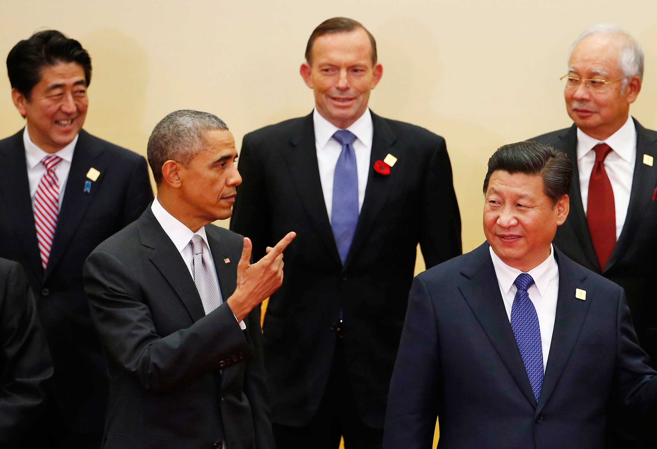 U.S. President Barack Obama gestures next to China's President Xi Jinping during the APEC leaders' meeting at the International Convention Center at Yanqi Lake in Beijing on Nov. 11, 2014.