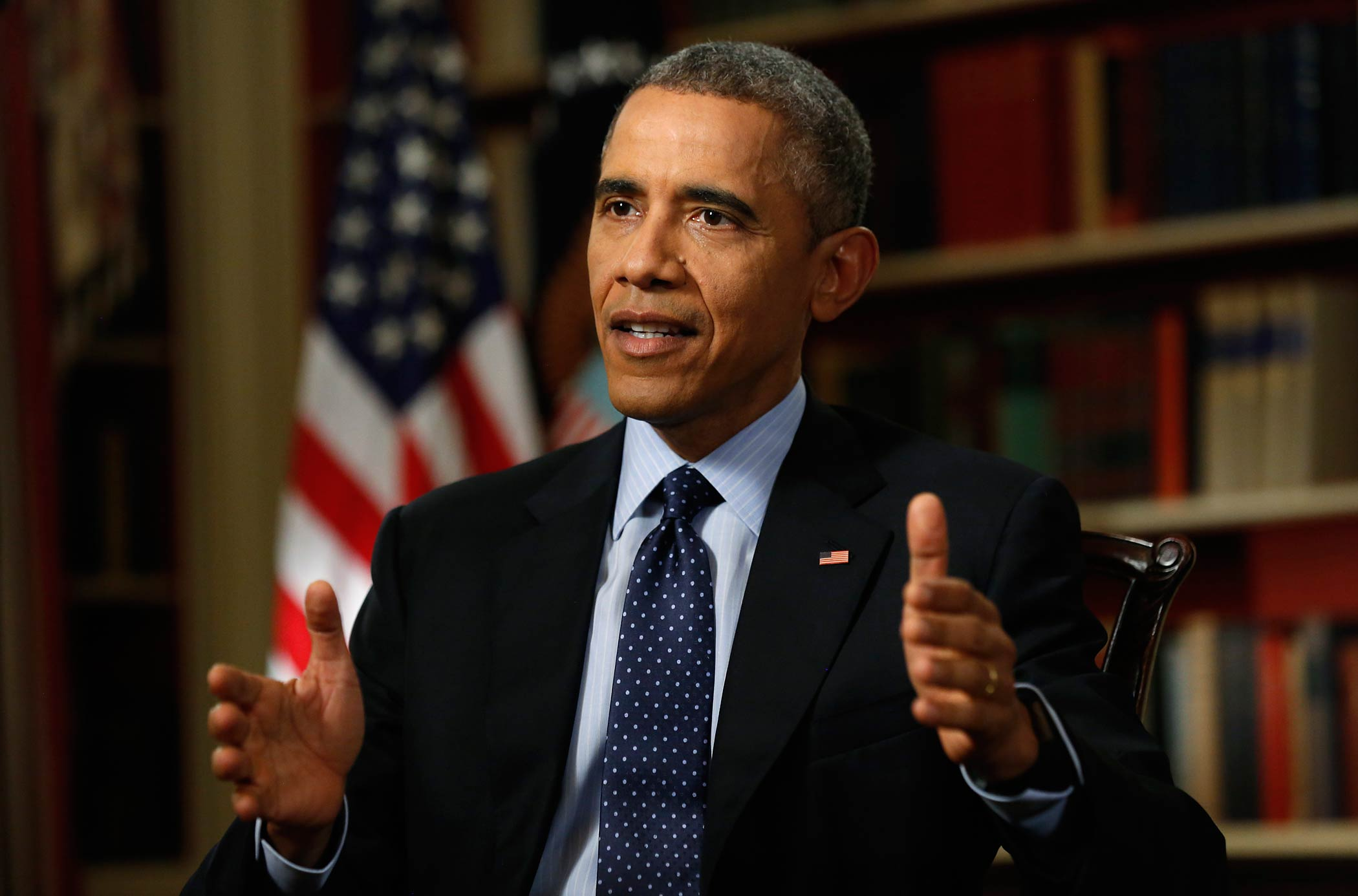 U.S. President Barack Obama speaks during an exclusive interview with Reuters in the Library of the White House in Washington March 2, 2015.