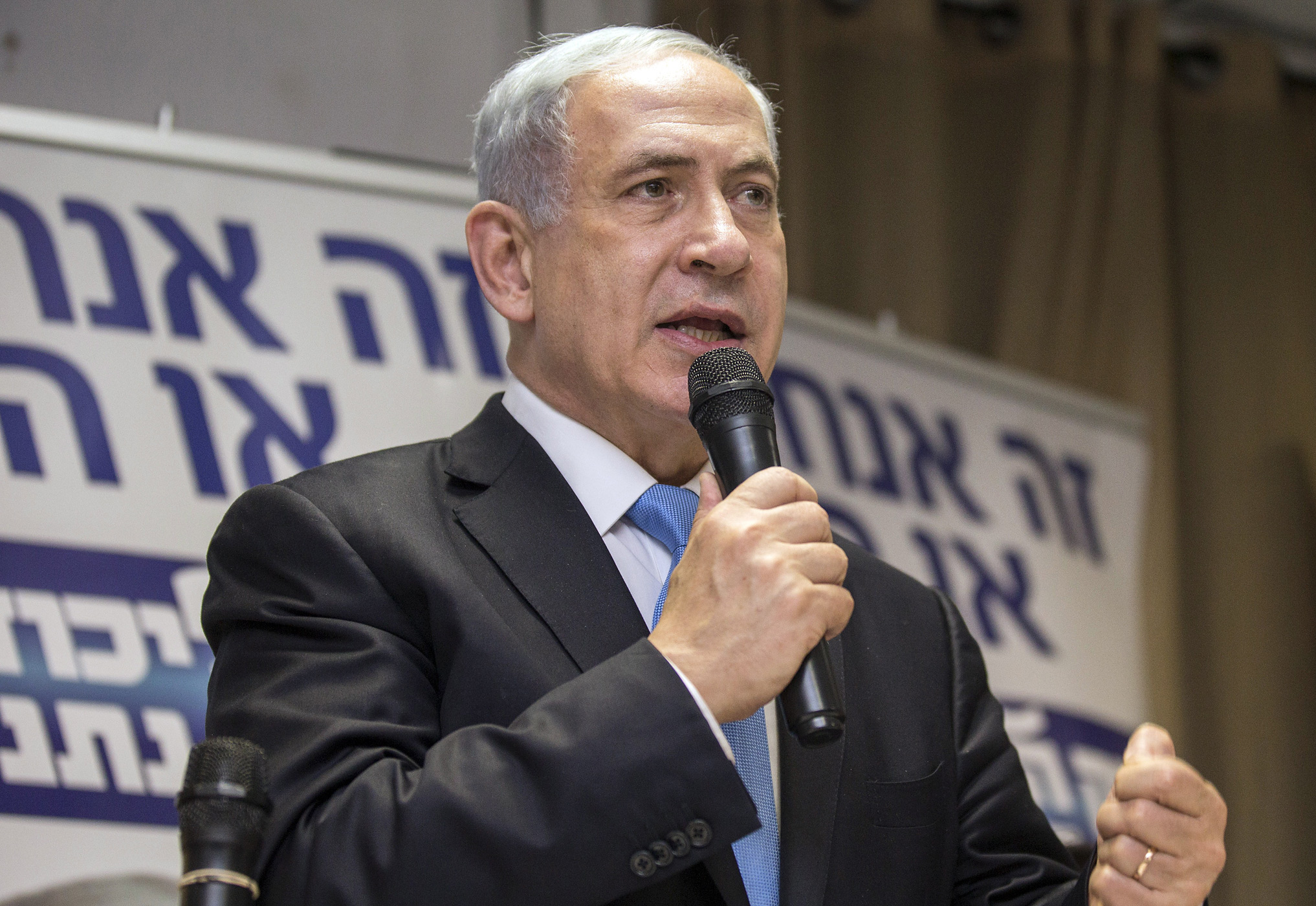 Israeli Prime Minister Benjamin Netanyahu delivers a speech during a campaign meeting with members of Israel's French-Jewish community on March 10, 2015, in Netanya, Israel