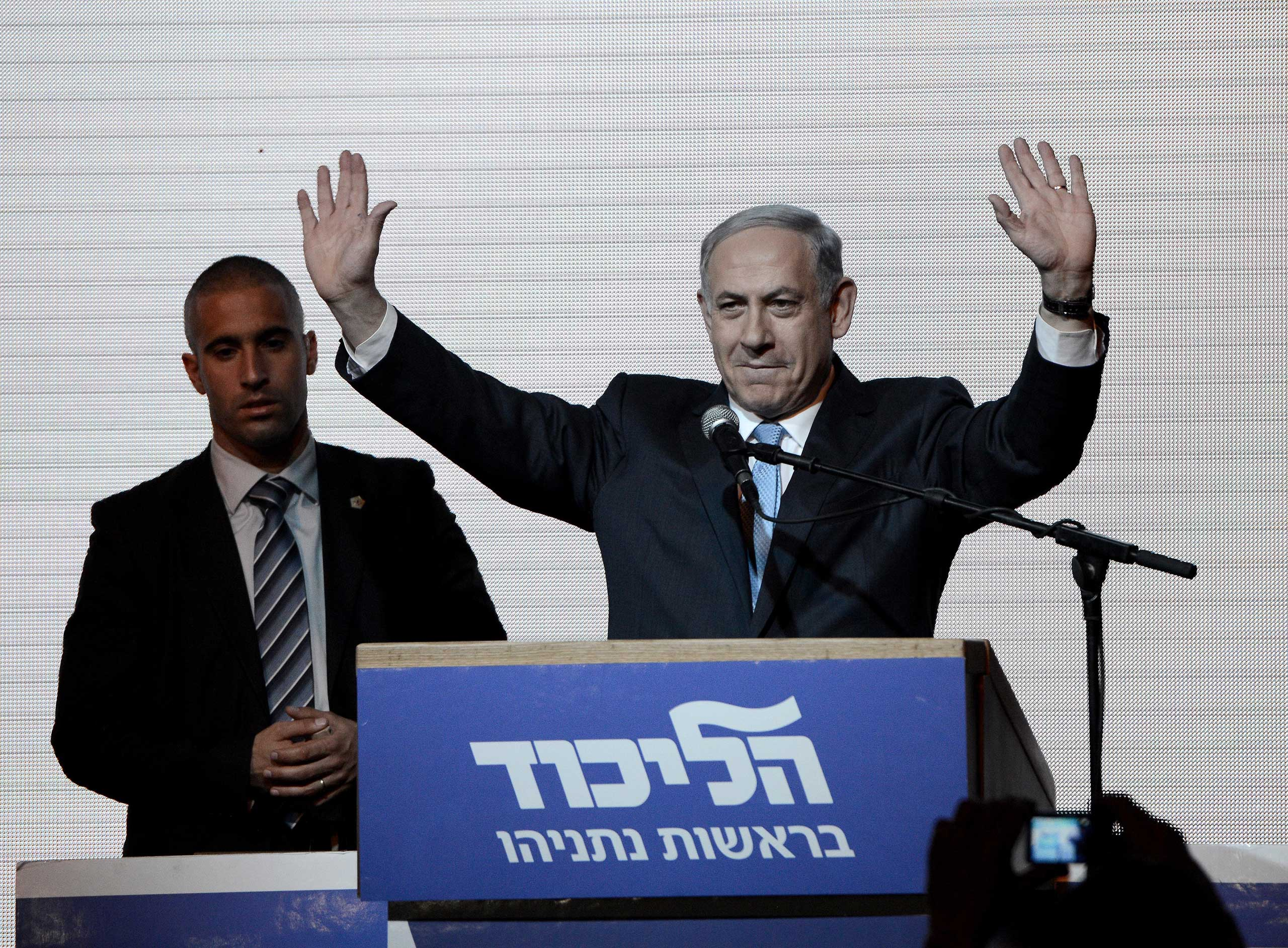 Israeli Prime Minister and the leader of the Likud Party Benjamin Netanyahu greets supporters at the party's election headquarters after the first results of the Israeli general election on March 18, 2015 in Tel Aviv, Israel.